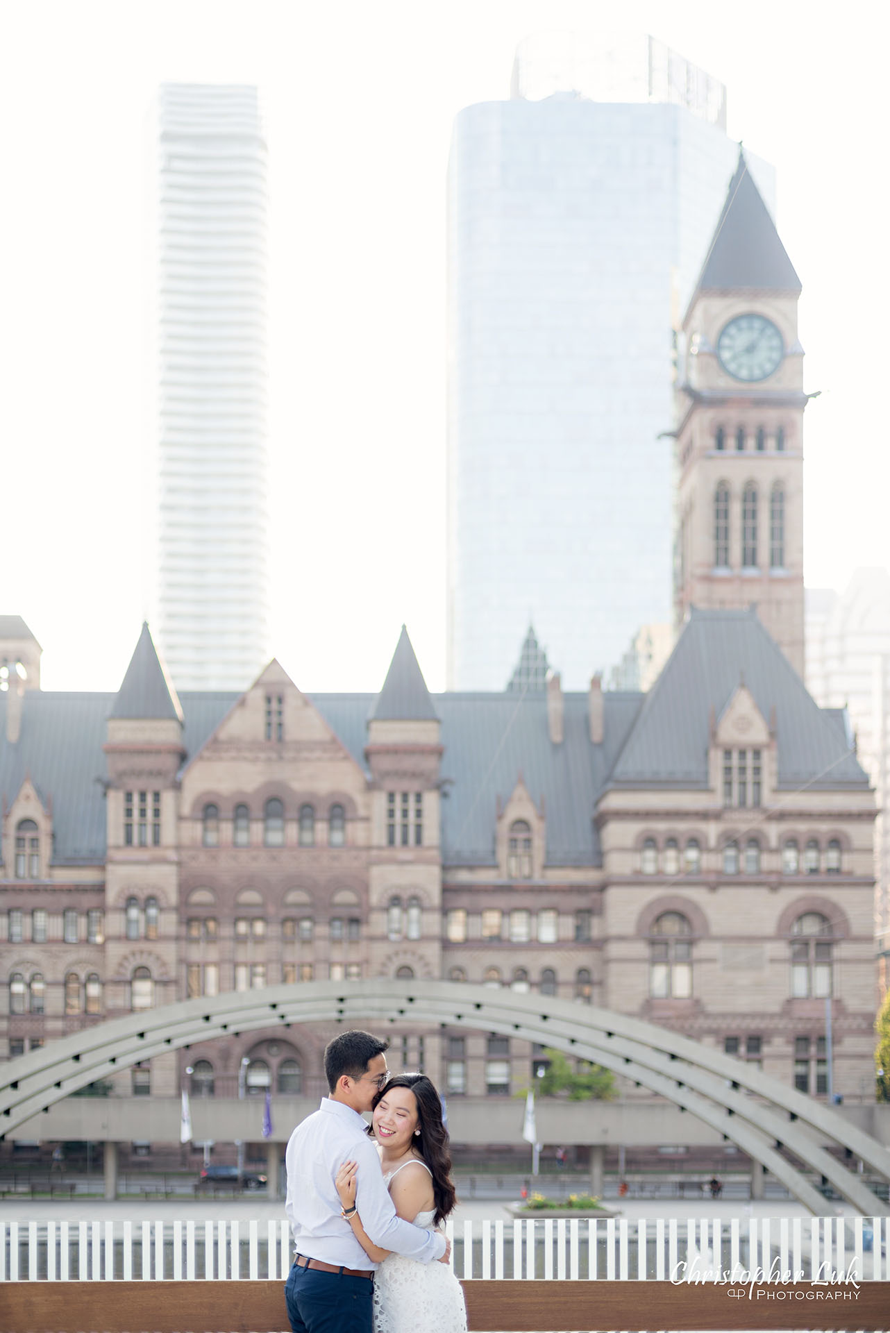 Christopher Luk Wedding Photographer Toronto City Hall Nathan Philips Square Elevated Bridge Arches Archway Bride Groom Hug Holding Each Other Intimate Natural Candid Photojournalistic Portrait