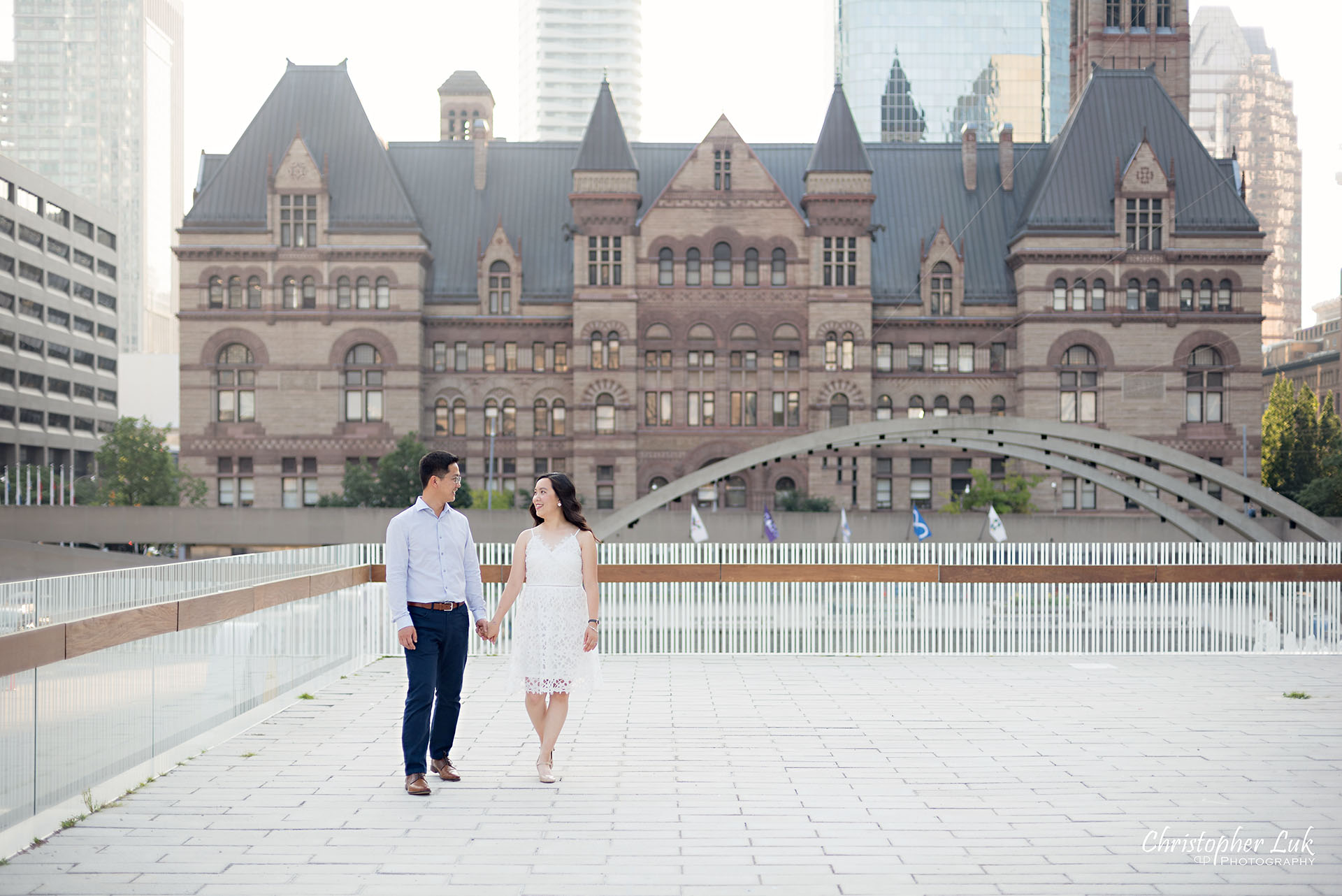 Christopher Luk Wedding Photographer Toronto City Hall Nathan Philips Square Elevated Bridge Arches Archway Bride Groom Holding Hands Walking Together Laughing Intimate Natural Candid Photojournalistic Wide Landscape