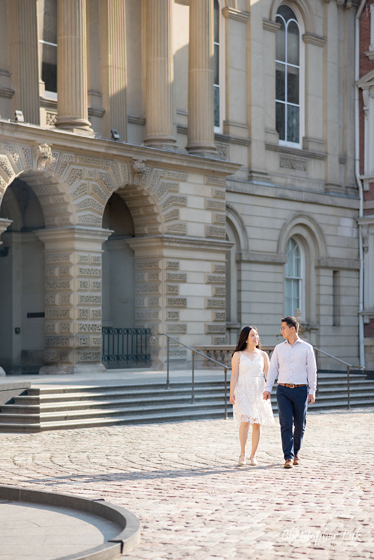 Christopher Luk Wedding Photographer Osgoode Hall Toronto Bride Groom Main Historic Building Front Cobblestone Sunrise Holding Hands Walking Together Portrait Natural Candid Photojournalistic