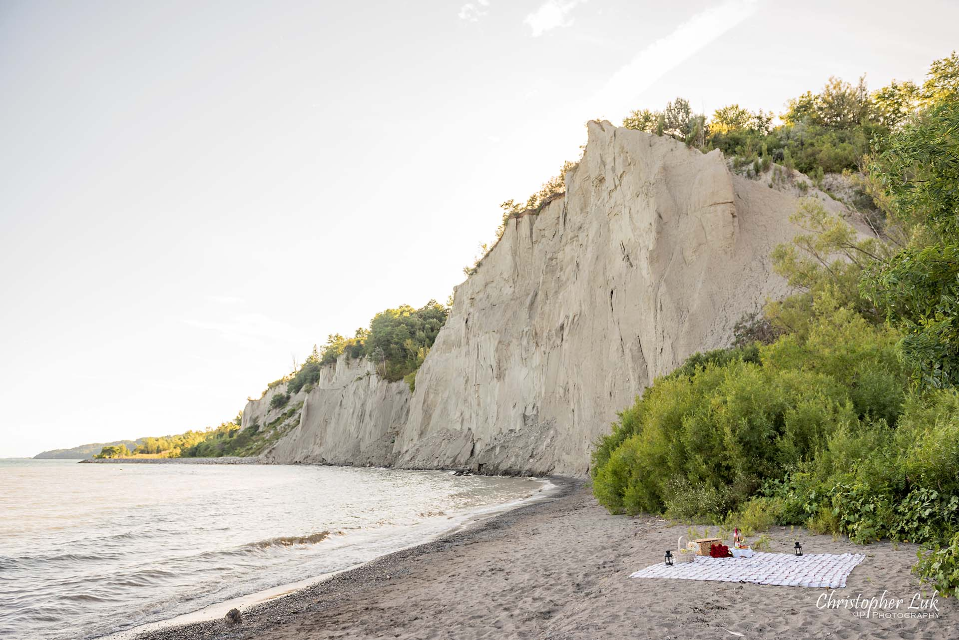 Christopher Luk Toronto Photographer Scarborough Bluffs Beach Park Sunset Surprise Wedding Marriage Engagement Proposal Cliff Stone Rock Face Picnic Blanket Basket Landscape Wide