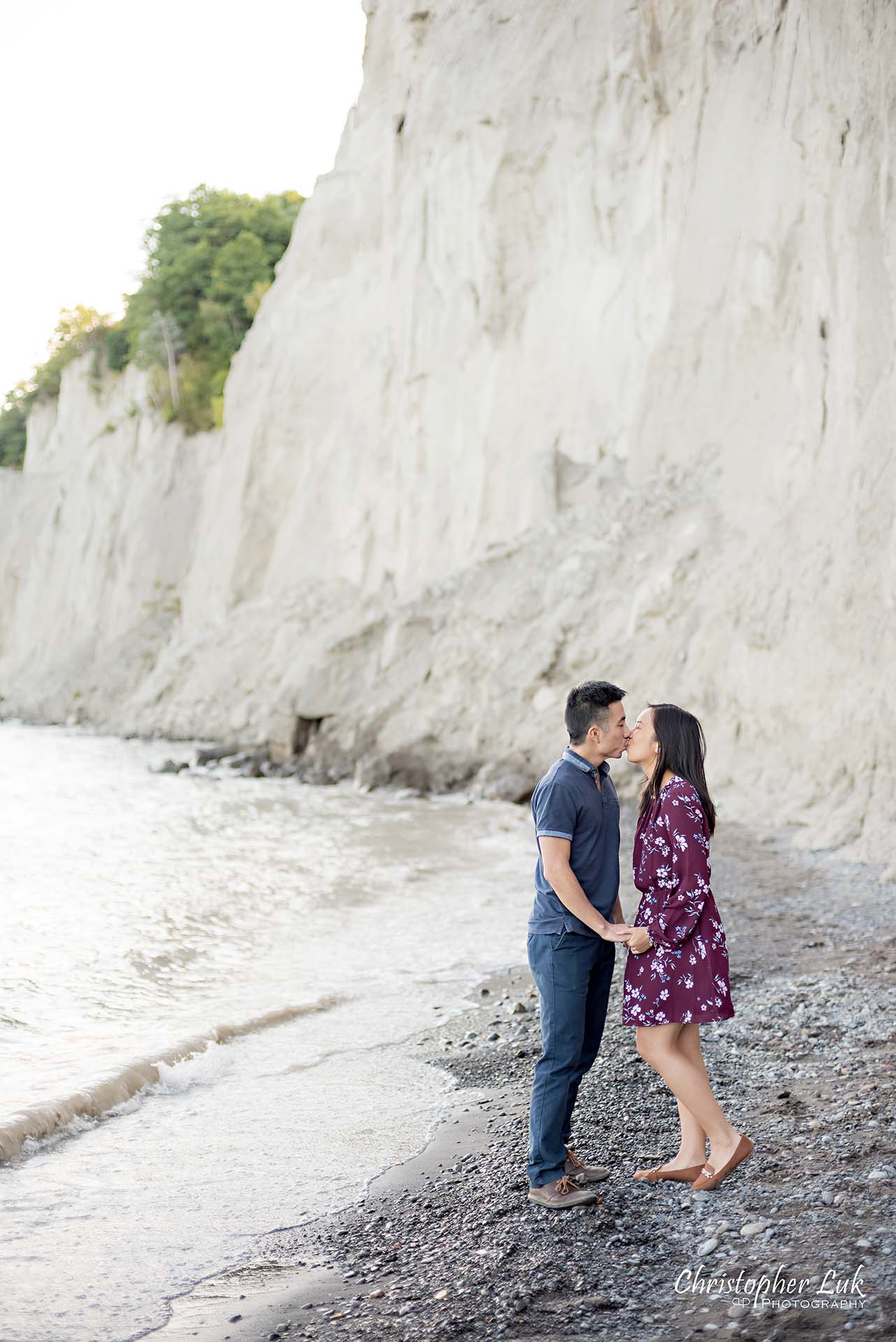 Christopher Luk Toronto Photographer Scarborough Bluffs Beach Park Sunset Surprise Wedding Marriage Engagement Proposal Candid Natural Photojournalistic Bride Groom Waterfront Water Lake Ontario Background Beachfront Sand Walking Together Holding Hands Edge of Water Smile Stone Portrait Kiss
