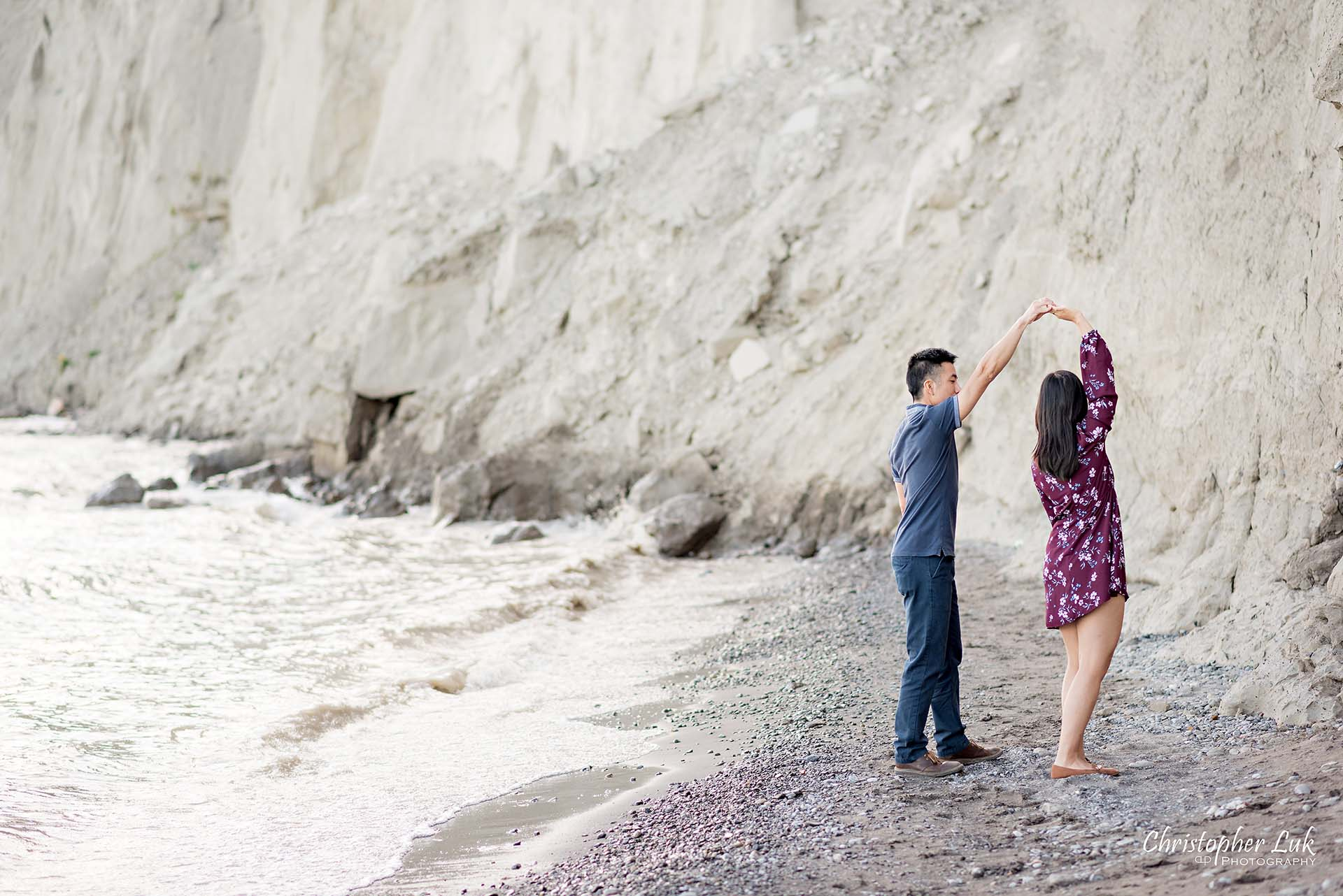 Christopher Luk Toronto Photographer Scarborough Bluffs Beach Park Sunset Surprise Wedding Marriage Engagement Proposal Candid Natural Photojournalistic Bride Groom Waterfront Water Lake Ontario Background Beachfront Sand Walking Together Holding Hands Edge of Water Smile Stone Dancing Spin Twirl Dance