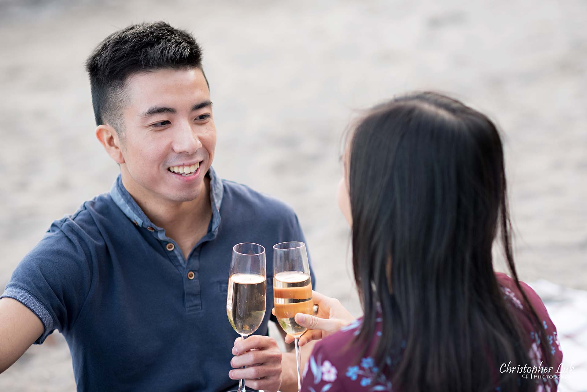 Christopher Luk Toronto Photographer Scarborough Bluffs Beach Park Sunset Surprise Wedding Marriage Engagement Proposal Candid Natural Photojournalistic Bride Groom Picnic Blanket Basket Teddy Bears Champagne Glasses Flutes Drinking Together Smile