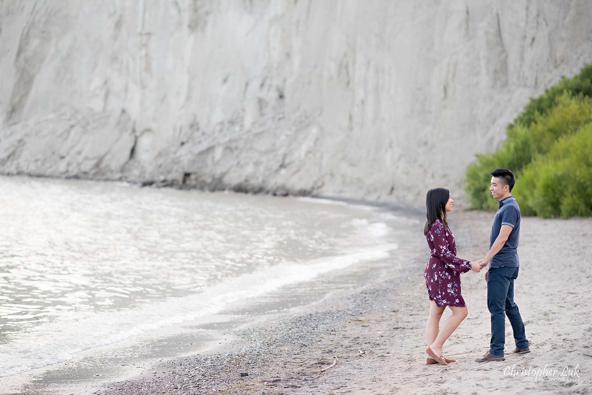 Christopher Luk Toronto Photographer Scarborough Bluffs Beach Park Sunset Surprise Wedding Marriage Engagement Proposal Candid Natural Photojournalistic Bride Groom Waterfront Water Lake Ontario Background Beachfront Sand Walking Together Holding Hands Edge of Water