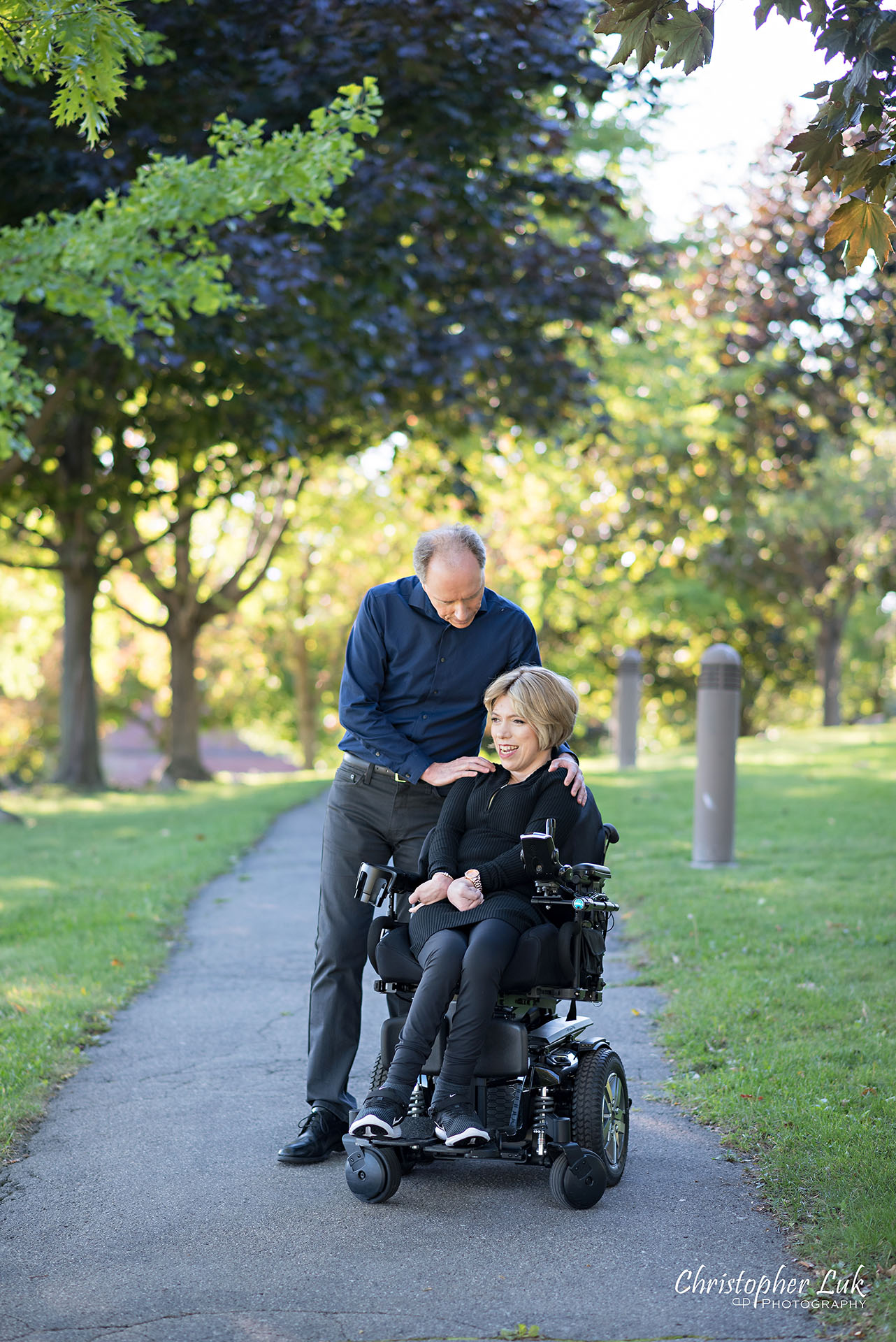 Christopher Luk Toronto Wedding Photographer Whitby Durham Engagement Session Bride Groom Candid Natural Photojournalistic Wheelchair Path Pathway Hug Shoulder