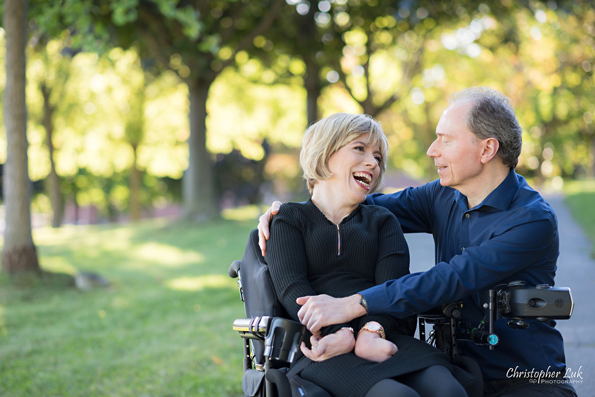 Christopher Luk Toronto Wedding Photographer Whitby Durham Engagement Session Bride Groom Candid Natural Photojournalistic Wheelchair Path Pathway Talking Together Wrap Arms Hug