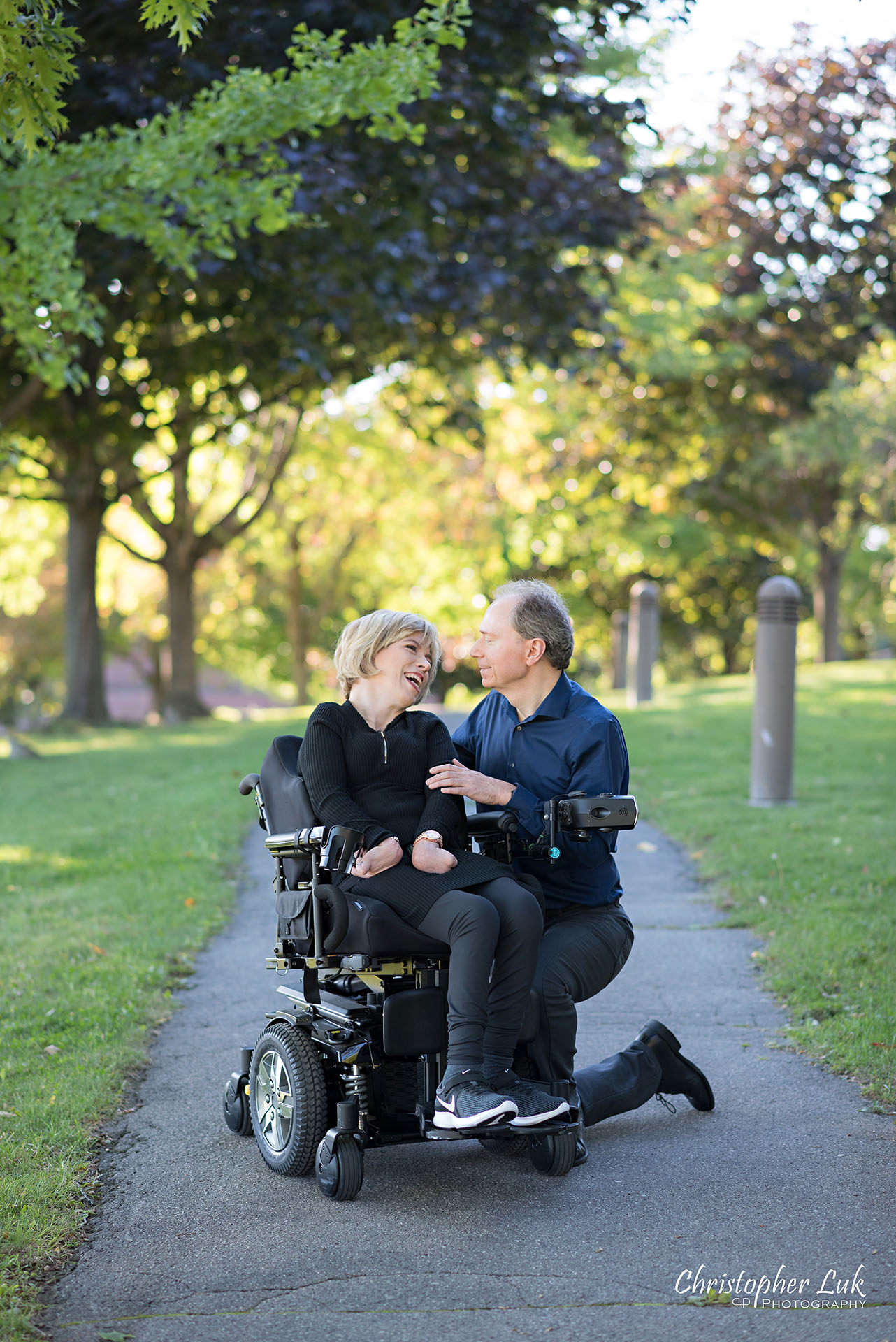 Christopher Luk Toronto Wedding Photographer Whitby Durham Engagement Session Bride Groom Candid Natural Photojournalistic Wheelchair Path Pathway Kneel Talking Together
