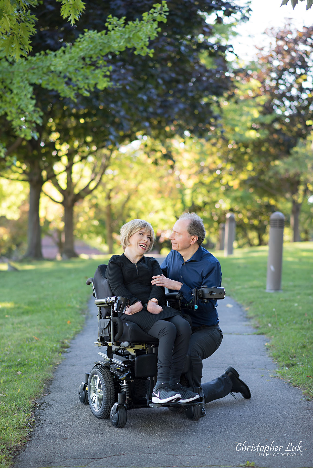 Christopher Luk Toronto Wedding Photographer Whitby Durham Engagement Session Bride Groom Candid Natural Photojournalistic Wheelchair Path Pathway Kneel Smile