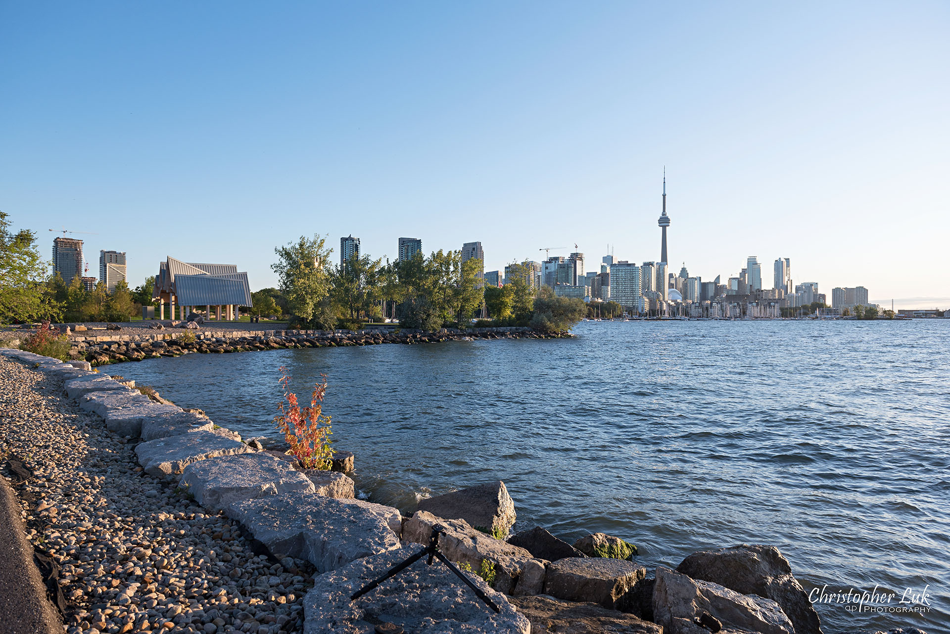 Christopher Luk Trillium Park Ontario Place Waterfront Engagement Session Toronto Wedding Photographer CN Tower Skyline Background Sunrise Wide Landscape Hotel X