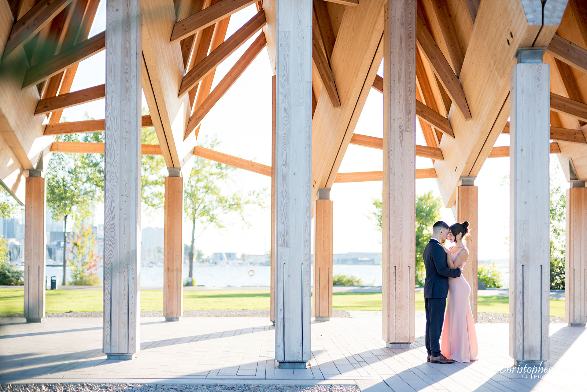 Christopher Luk Trillium Park Ontario Place Waterfront Engagement Session Toronto Wedding Photographer Bride Groom Natural Candid Photojournalistic Wood Evergreen Pavilion Landscape Hug