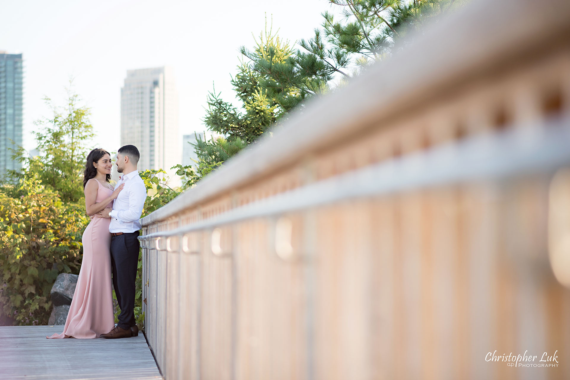 Christopher Luk Trillium Park Ontario Place Waterfront Engagement Session Toronto Wedding Photographer Bride Groom Natural Candid Photojournalistic Standing Together Hug Intimate Ravine Bridge