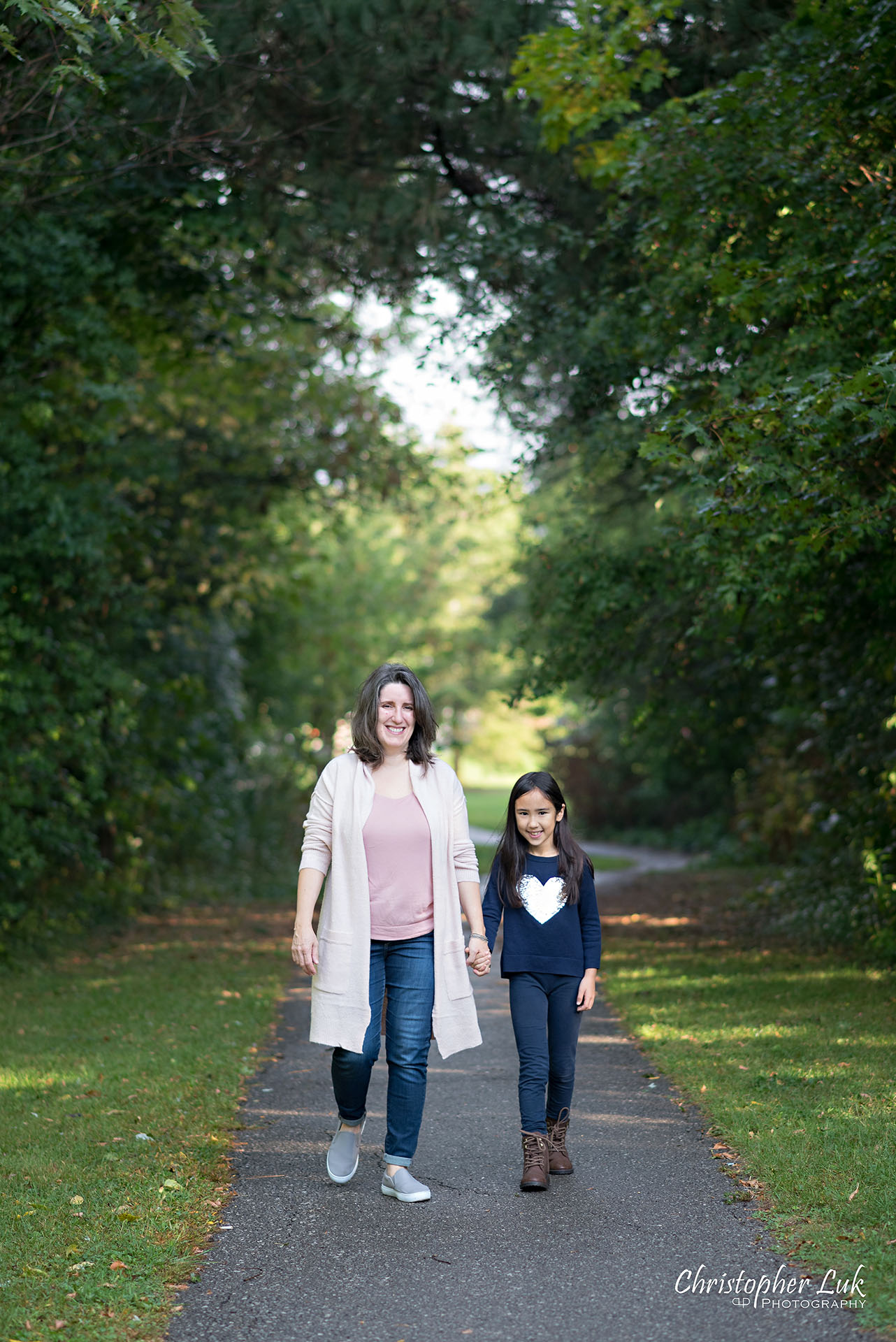 Christopher Luk Family Photographer Toronto Markham Candid Natural Photojournalistic Mother Daughter Walking Together Holding Hands