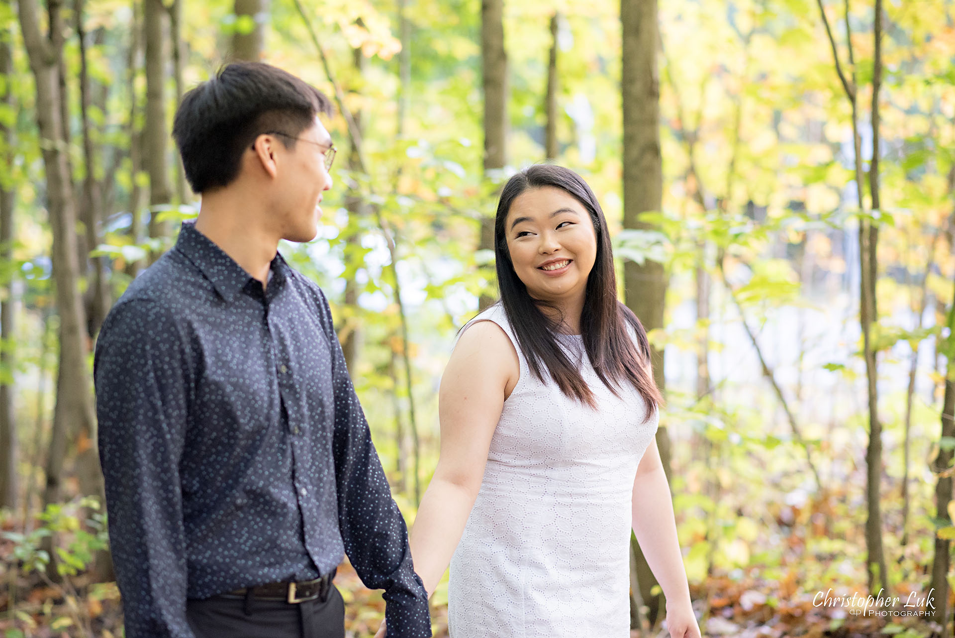 Christopher Luk Toronto Wedding Photographer Stouffville Forest Conservation Park Engagement Session Candid Natural Photojournalistic Bride Groom Walking Together Pond Autumn Fall Leaves