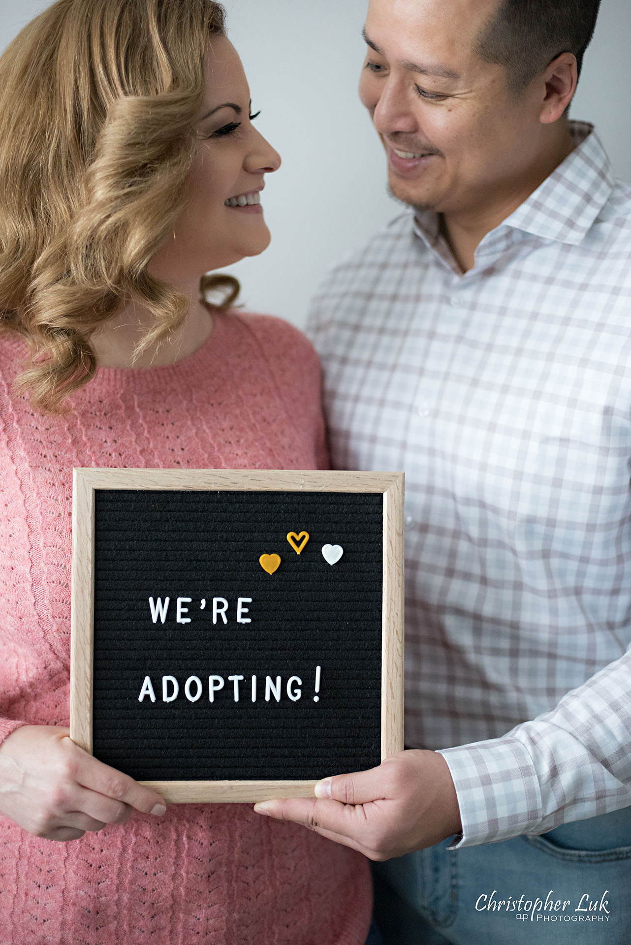 Christopher Luk Toronto Markham Family Adoption LifeBook Photographer Pictures Photos Children Session Parents We're Adopting Letter Board Sign Smile Vertical Portrait