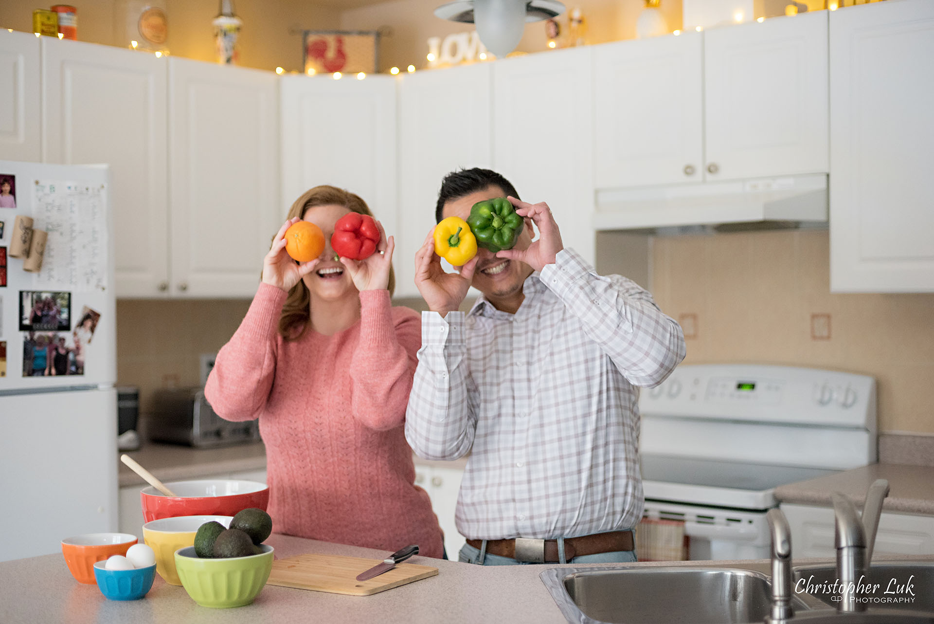 Christopher Luk Toronto Markham Family Adoption LifeBook Photographer Pictures Photos Children Session Parents Kitchen Preparation Life at Home Colourful Fun Bell Peppers Orange Eyes Eyeballs Funny