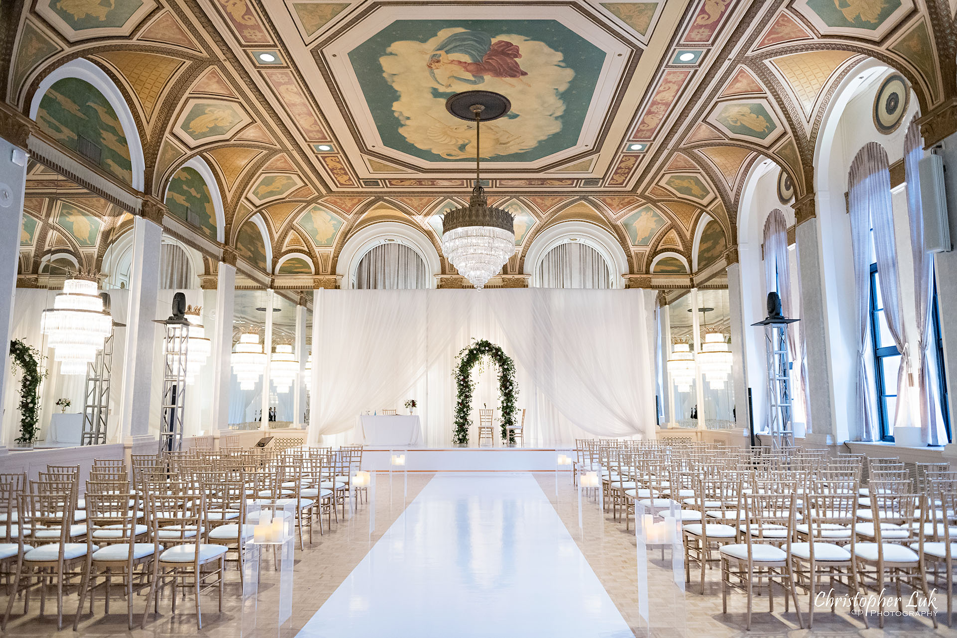 Toronto Fairmont Royal York Hotel Wedding Christopher Luk Photographer Photography Crystal Chandelier Ballroom Ceremony Setup Vinyl Floor Floral Arch Aisle Dance Floor Decor Chiavari Chairs