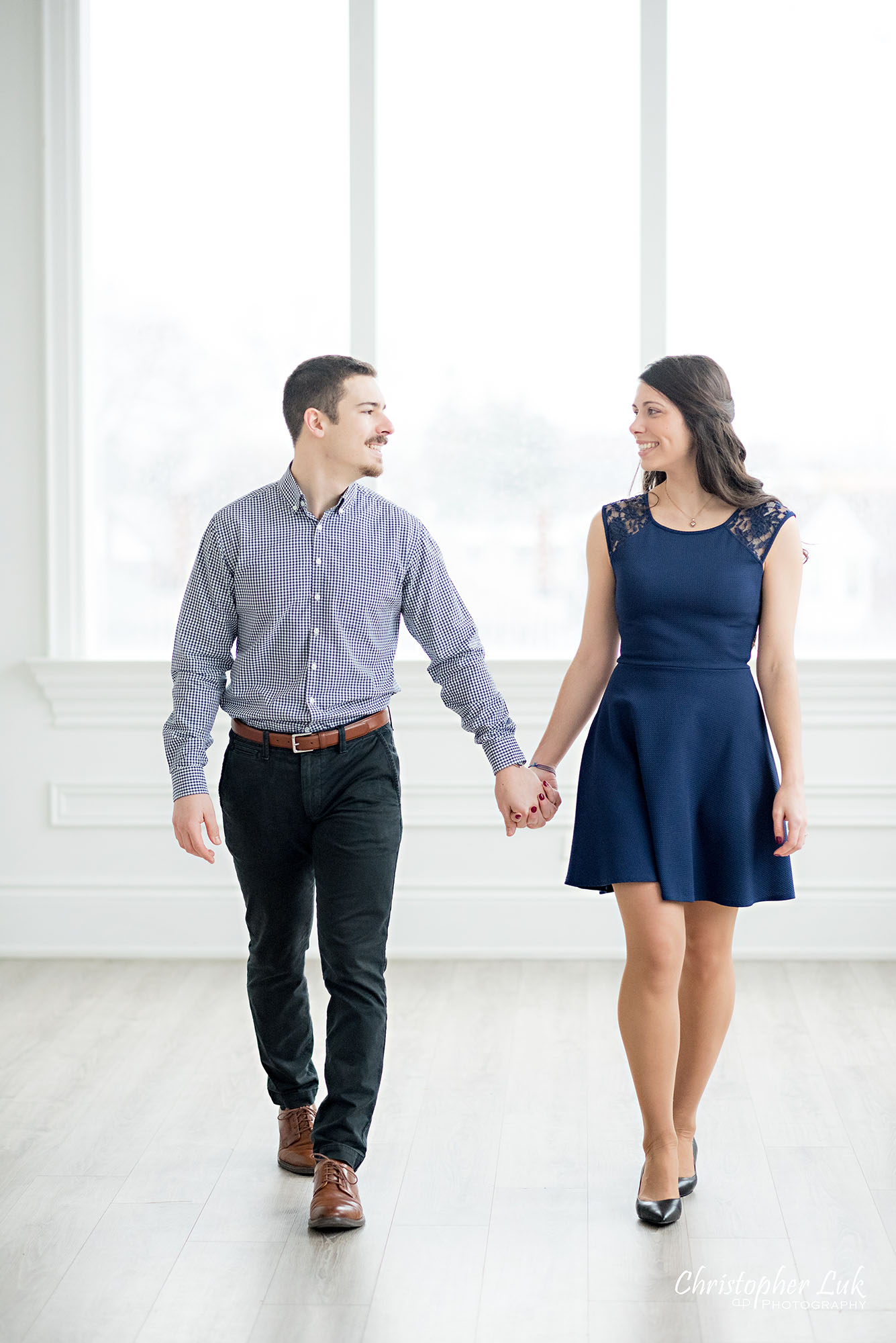 Christopher Luk Toronto Wedding Photographer Mint Room Studios Conservatory Engagement Session Winter Indoor Natural Light Candid Photojournalistic Bride Groom Holding Hands Walking Together Smile Vertical