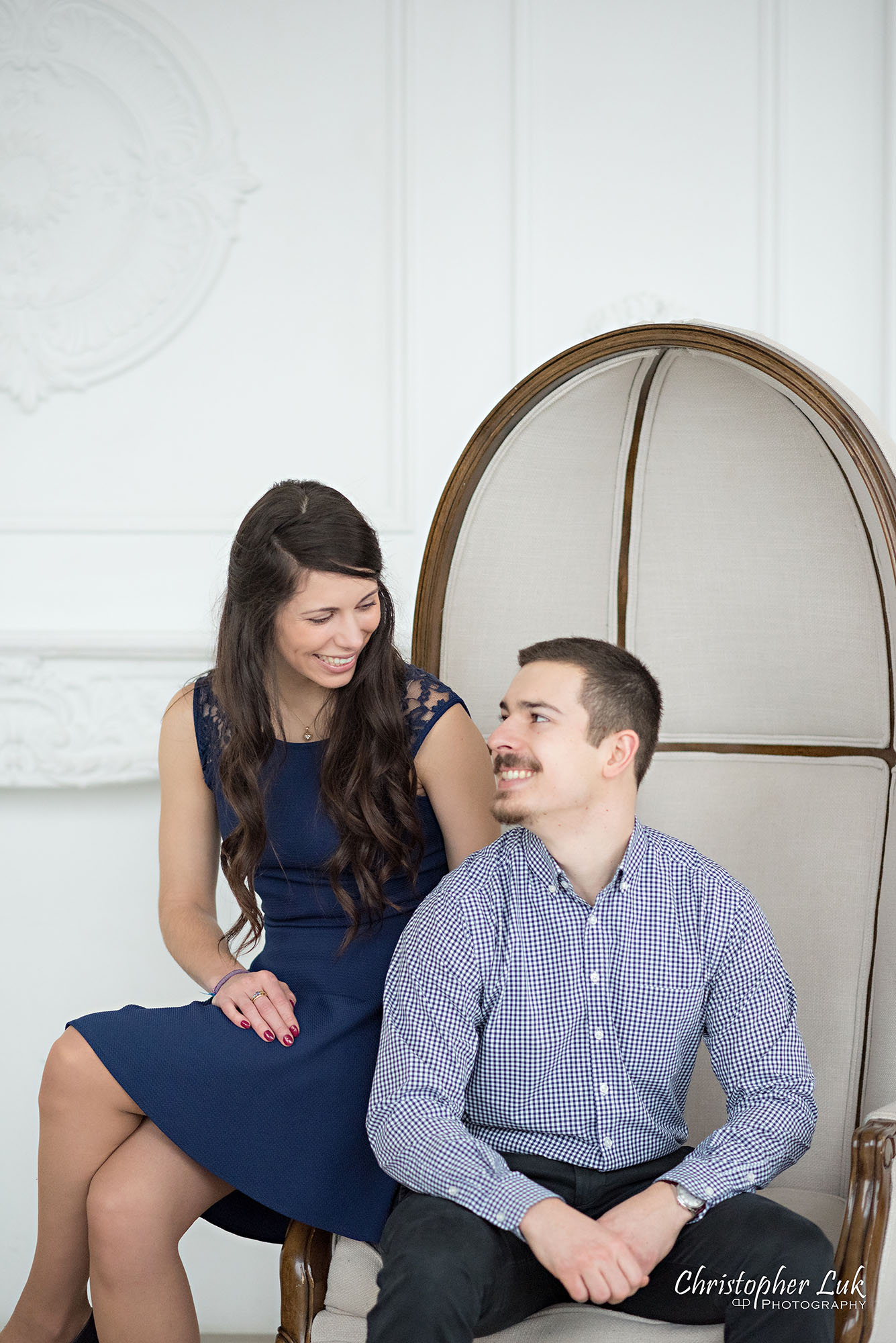 Christopher Luk Toronto Wedding Photographer Mint Room Studios Conservatory Engagement Session Winter Indoor Natural Light Candid Photojournalistic Bride Groom Beige Dome Chair Smile Portrait