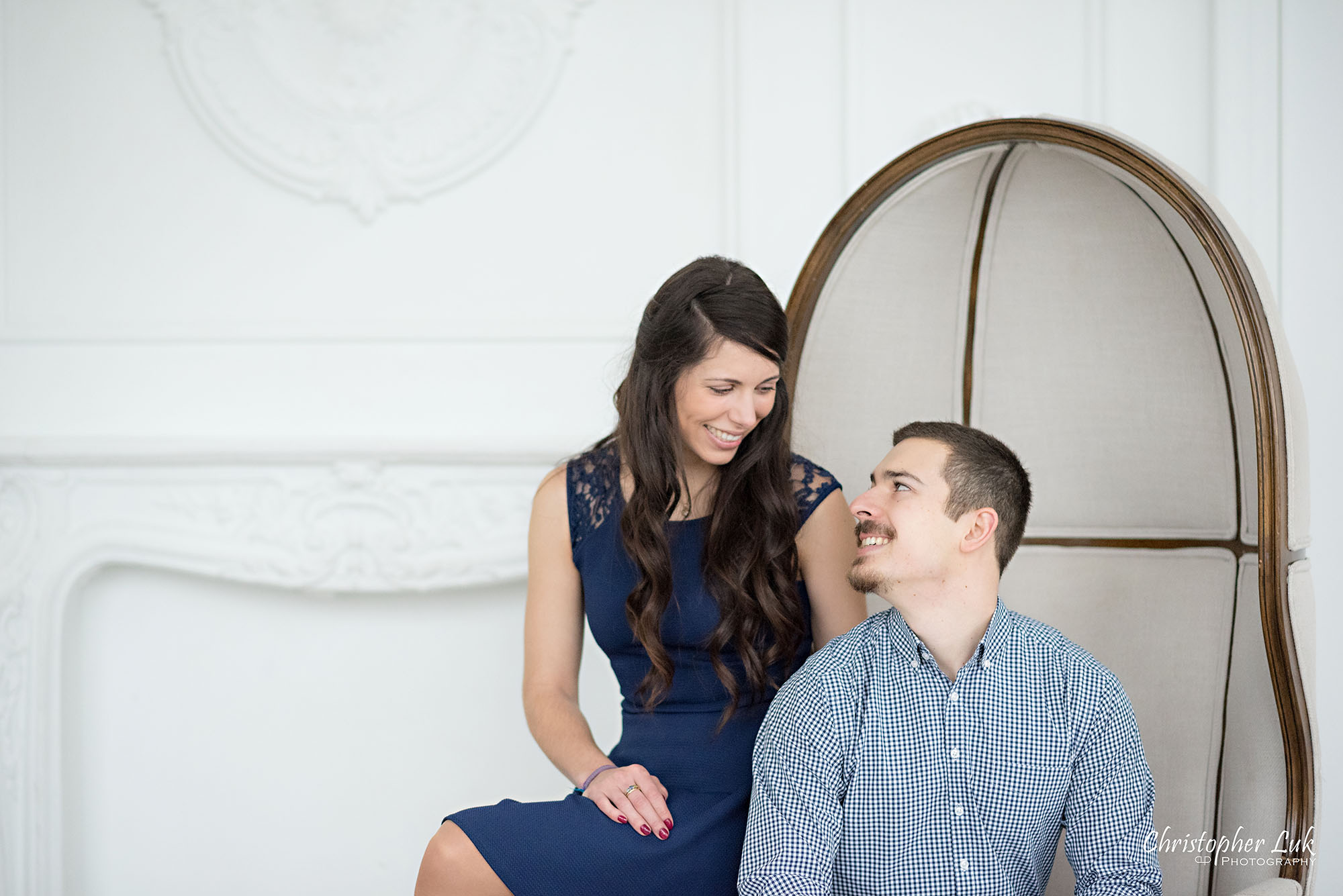 Christopher Luk Toronto Wedding Photographer Mint Room Studios Conservatory Engagement Session Winter Indoor Natural Light Candid Photojournalistic Bride Groom Beige Dome Chair Smile