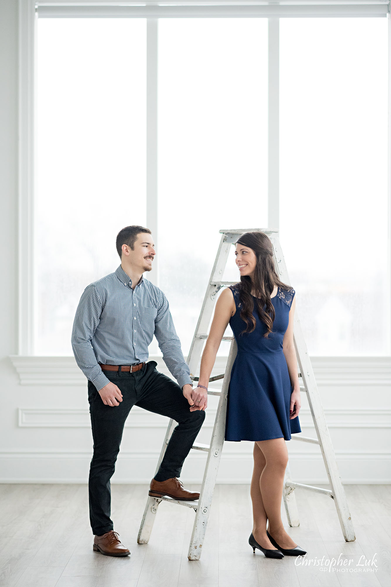Christopher Luk Toronto Wedding Photographer Mint Room Studios Conservatory Engagement Session Winter Indoor Natural Light Candid Photojournalistic Bride Groom Vintage Rustic Ladder Window Holding Hands