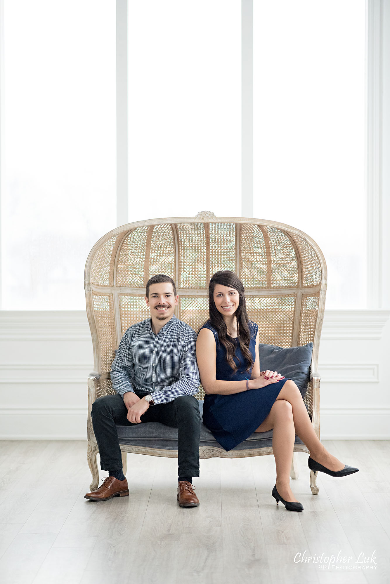 Christopher Luk Toronto Wedding Photographer Mint Room Studios Conservatory Engagement Session Winter Indoor Natural Light Candid Photojournalistic Bride Groom Wicker French Rustic Vintage Dome Loveseat Chair Smile