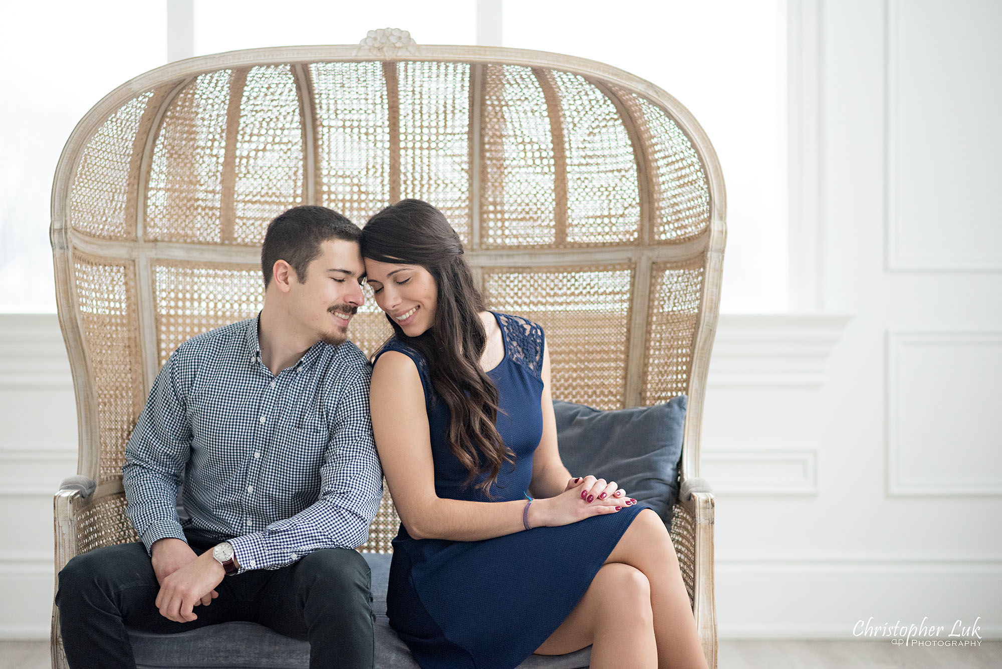 Christopher Luk Toronto Wedding Photographer Mint Room Studios Conservatory Engagement Session Winter Indoor Natural Light Candid Photojournalistic Bride Groom Wicker French Rustic Vintage Dome Loveseat Chair Snuggle Touch Adorable Cute Intimate