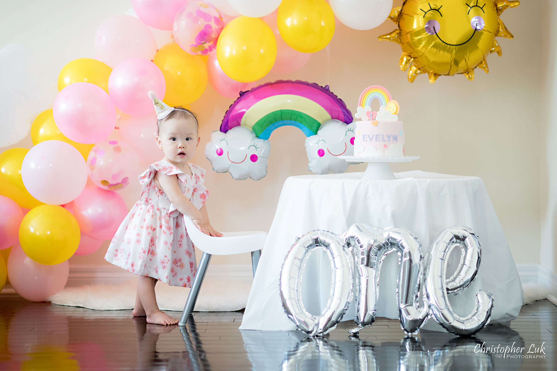 Christopher Luk Toronto Markham Family Photographer Baby Girl First Birthday Balloon Arch Rainbow Pink Hat Rainbow Sun Cake