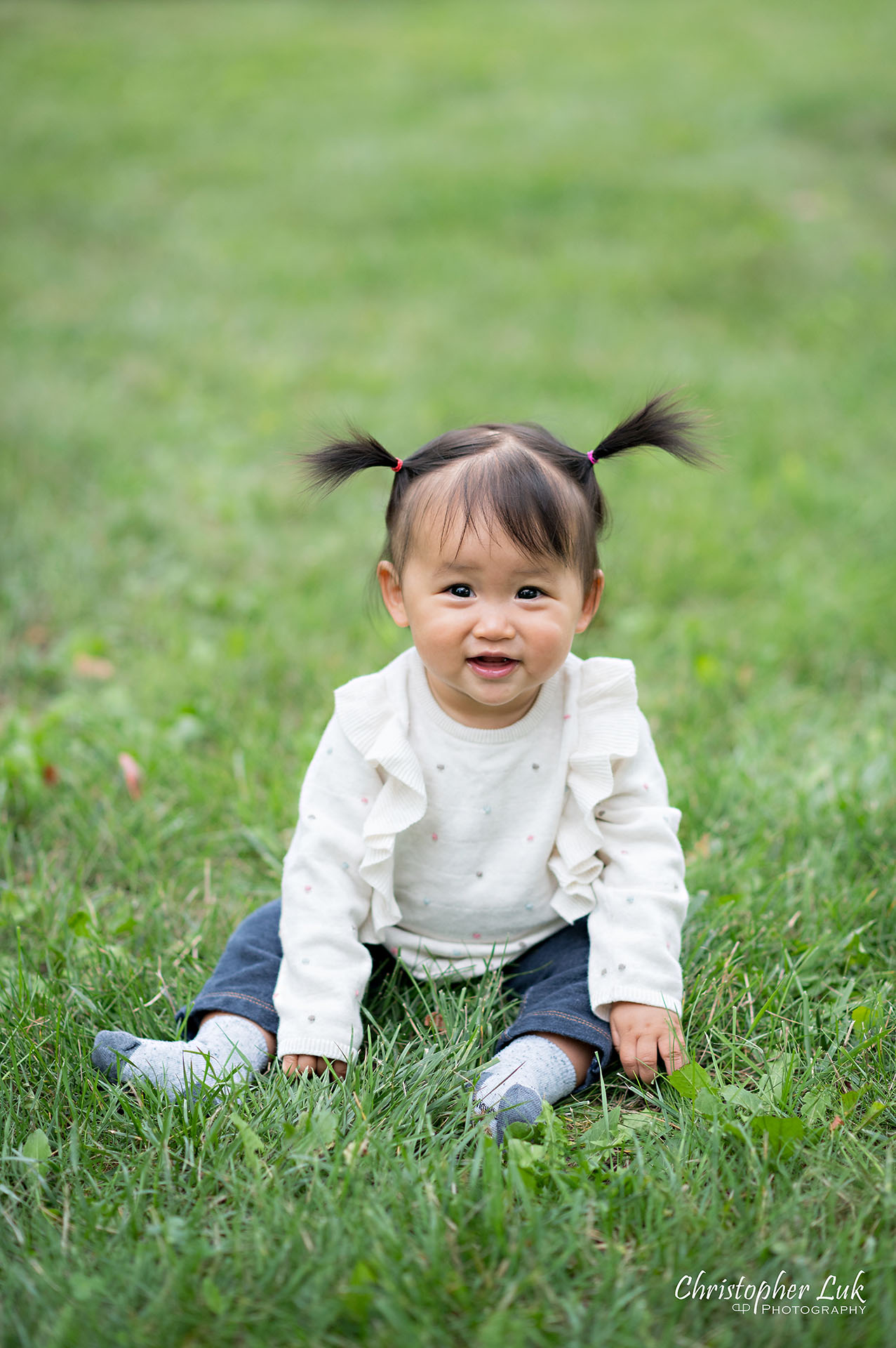 Christopher Luk Toronto Markham Family Wedding Photographer Baby Girl Natural Candid Photojournalistic Sitting Smiling Happy Pig Tails Portrait