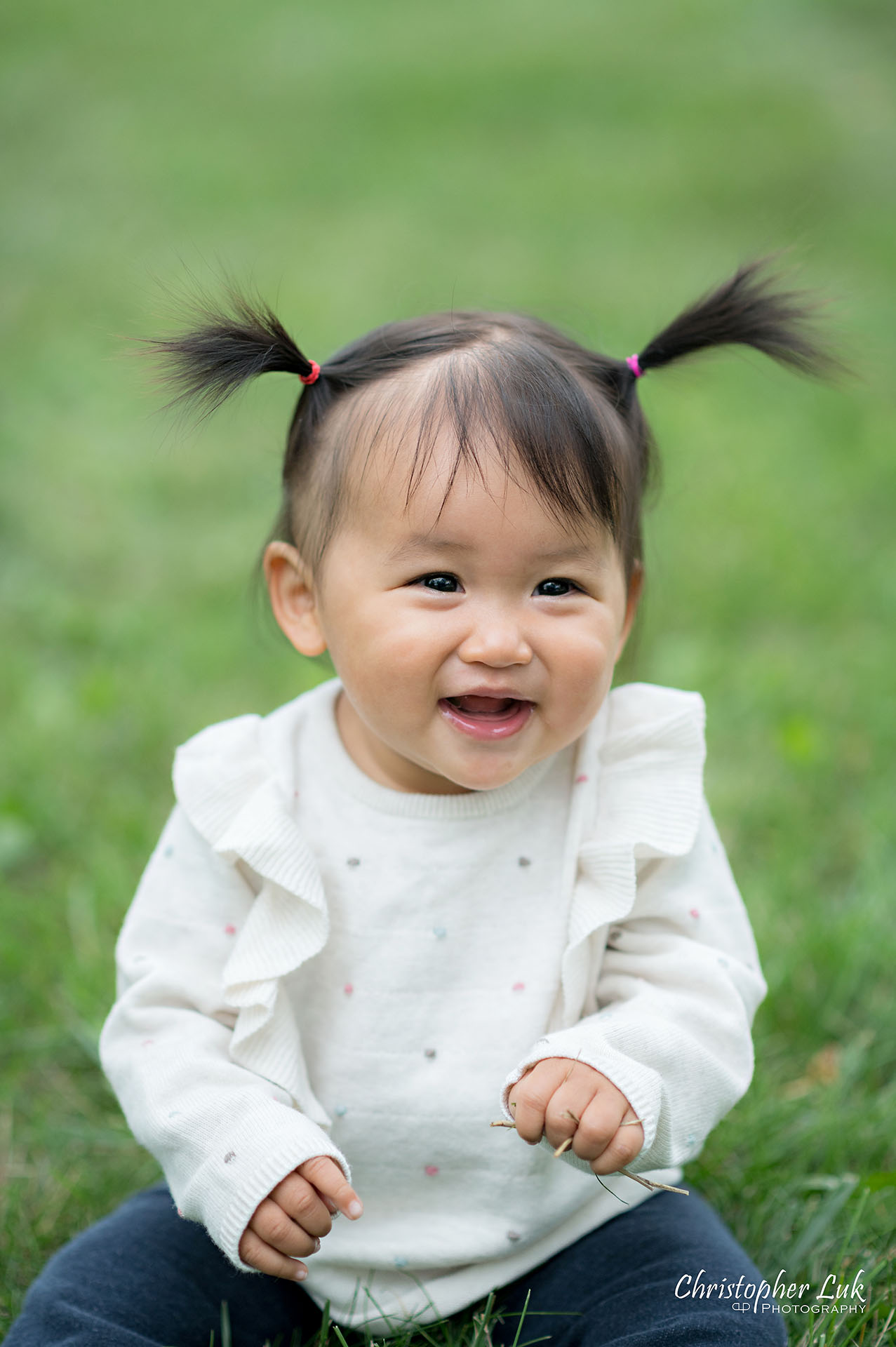 Christopher Luk Toronto Markham Family Wedding Photographer Baby Girl Natural Candid Photojournalistic Sitting Smiling Happy Portrait Close Up Detail Pig Tails