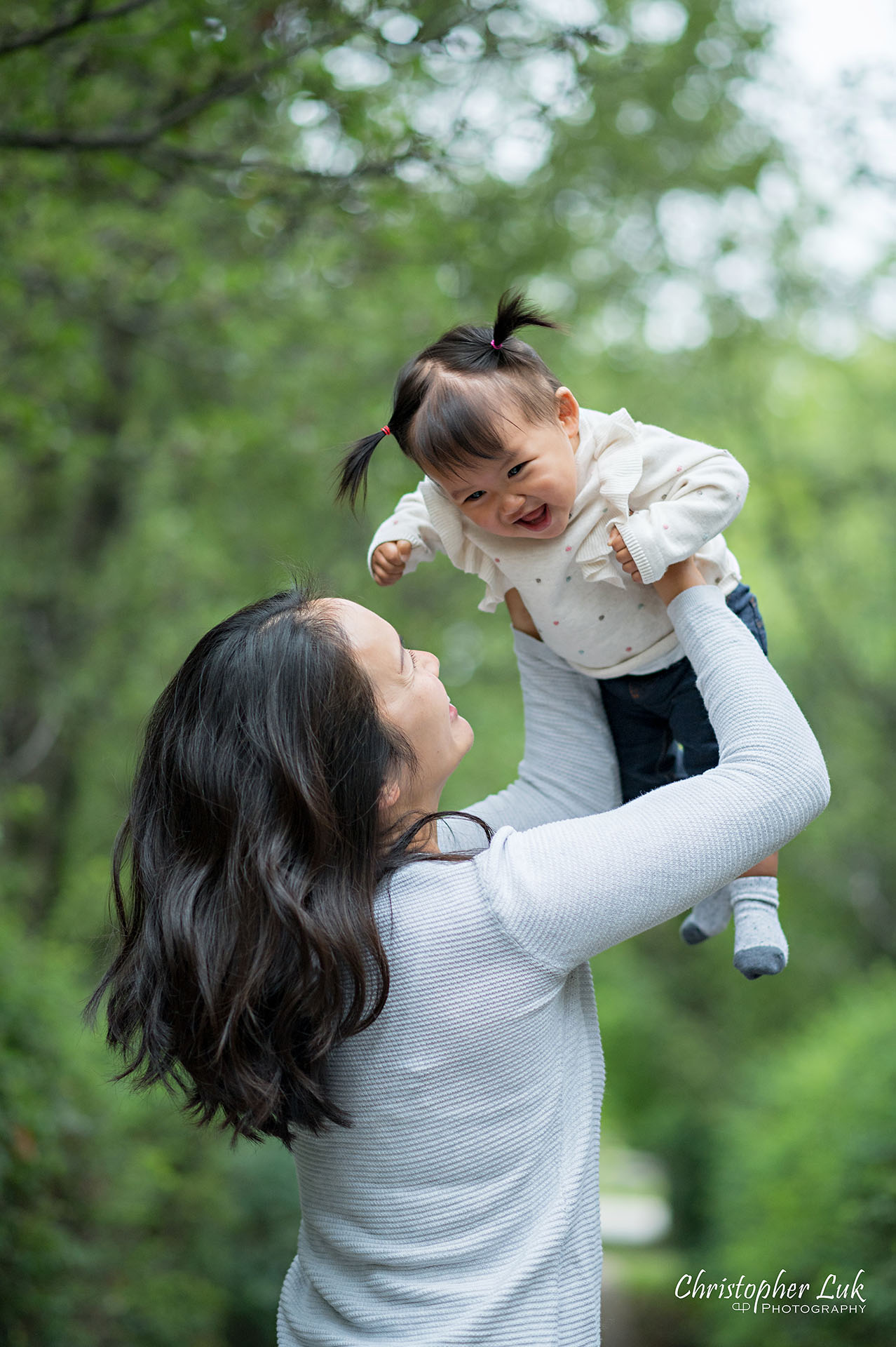 Christopher Luk Toronto Markham Family Wedding Photographer Baby Girl Natural Candid Photojournalistic Mom Mother Motherhood Daughter Lift Up in Air Kiss Fun Vertical Portrait Smiling Laughing