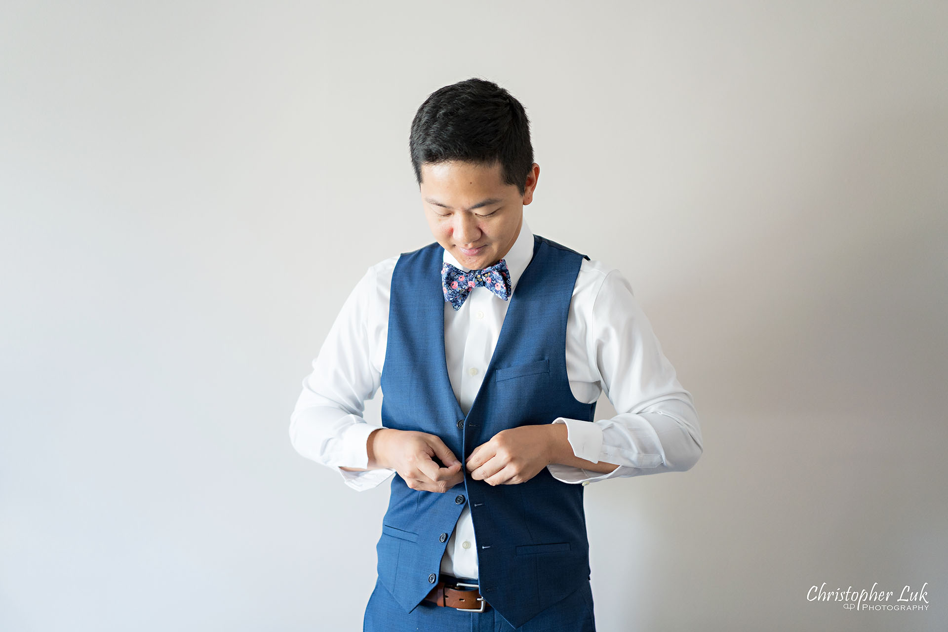 Christopher Luk Toronto Wedding Photographer Bridle Trail Baptist Church Unionville Main Street Crystal Fountain Event Venue Groom Vest Blue Navy Waistcoat Getting Ready Natural Photojournalistic Candid Smile