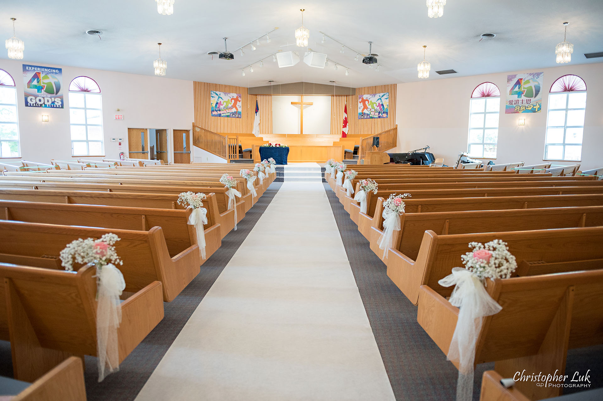 Christopher Luk Toronto Wedding Photographer Bridle Trail Baptist Church Unionville Main Street Crystal Fountain Event Venue Ceremony Location Interior Pews Rows Flowers Little White Baby's Breath Rose Pink Drapery Fabric Flower Bell by Masami Decor