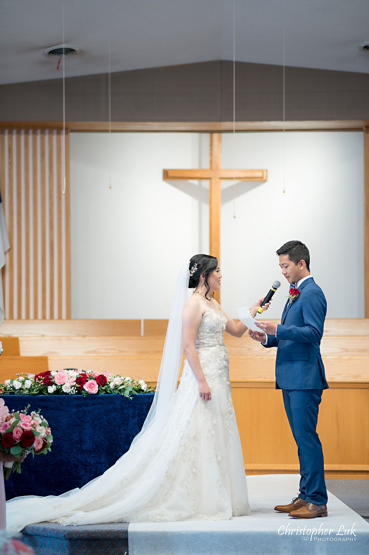 Christopher Luk Toronto Wedding Photographer Bridle Trail Baptist Church Unionville Main Street Crystal Fountain Event Venue Ceremony Location Interior Bride Groom Sanctuary Natural Photojournalistic Candid Vows Vertical Portrait Cross Altar Stage