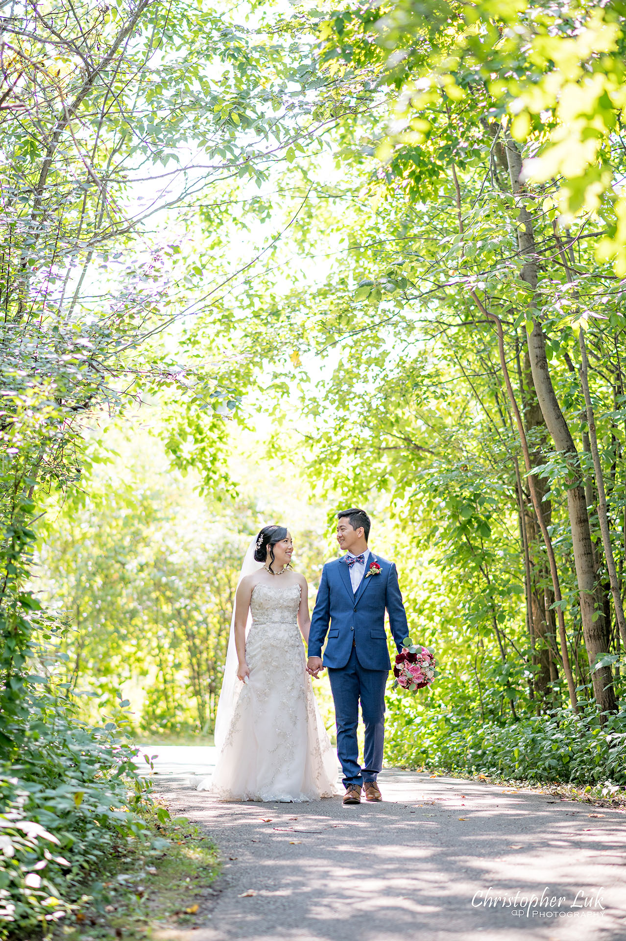 Christopher Luk Toronto Wedding Photographer Bridle Trail Baptist Church Unionville Main Street Crystal Fountain Event Venue Bride Groom Natural Photojournalistic Candid Creative Portrait Session Pictures Holding Hands Walking Together Path Trail Walkway Park Forest