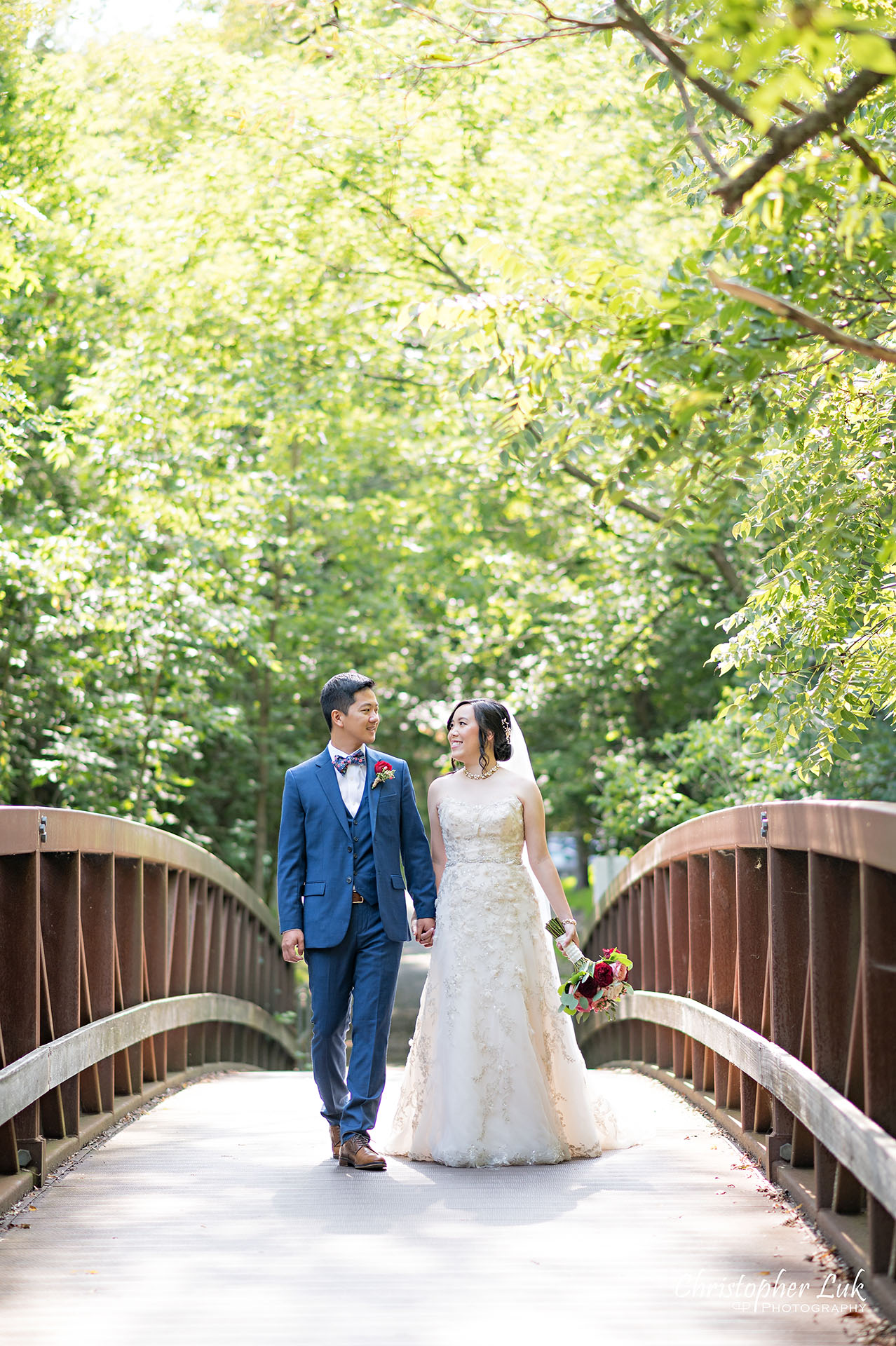 Christopher Luk Toronto Wedding Photographer Bridle Trail Baptist Church Unionville Main Street Crystal Fountain Event Venue Bride Groom Natural Photojournalistic Candid Creative Portrait Session Pictures Forest Trail Walkway Bridge Park Holding Hands Walking Together