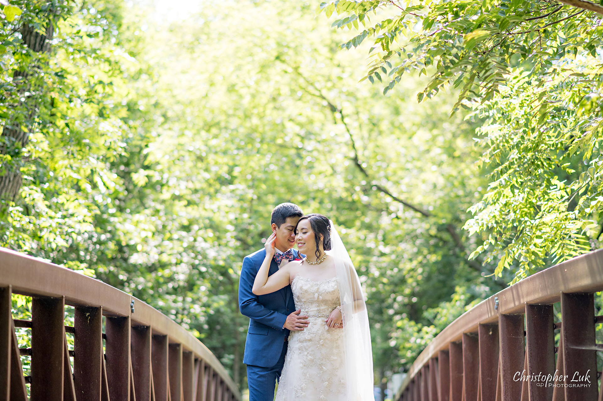 Christopher Luk Toronto Wedding Photographer Bridle Trail Baptist Church Unionville Main Street Crystal Fountain Event Venue Bride Groom Natural Photojournalistic Candid Creative Portrait Session Pictures Forest Trail Walkway Bridge Park Hug Kiss Portrait Intimate