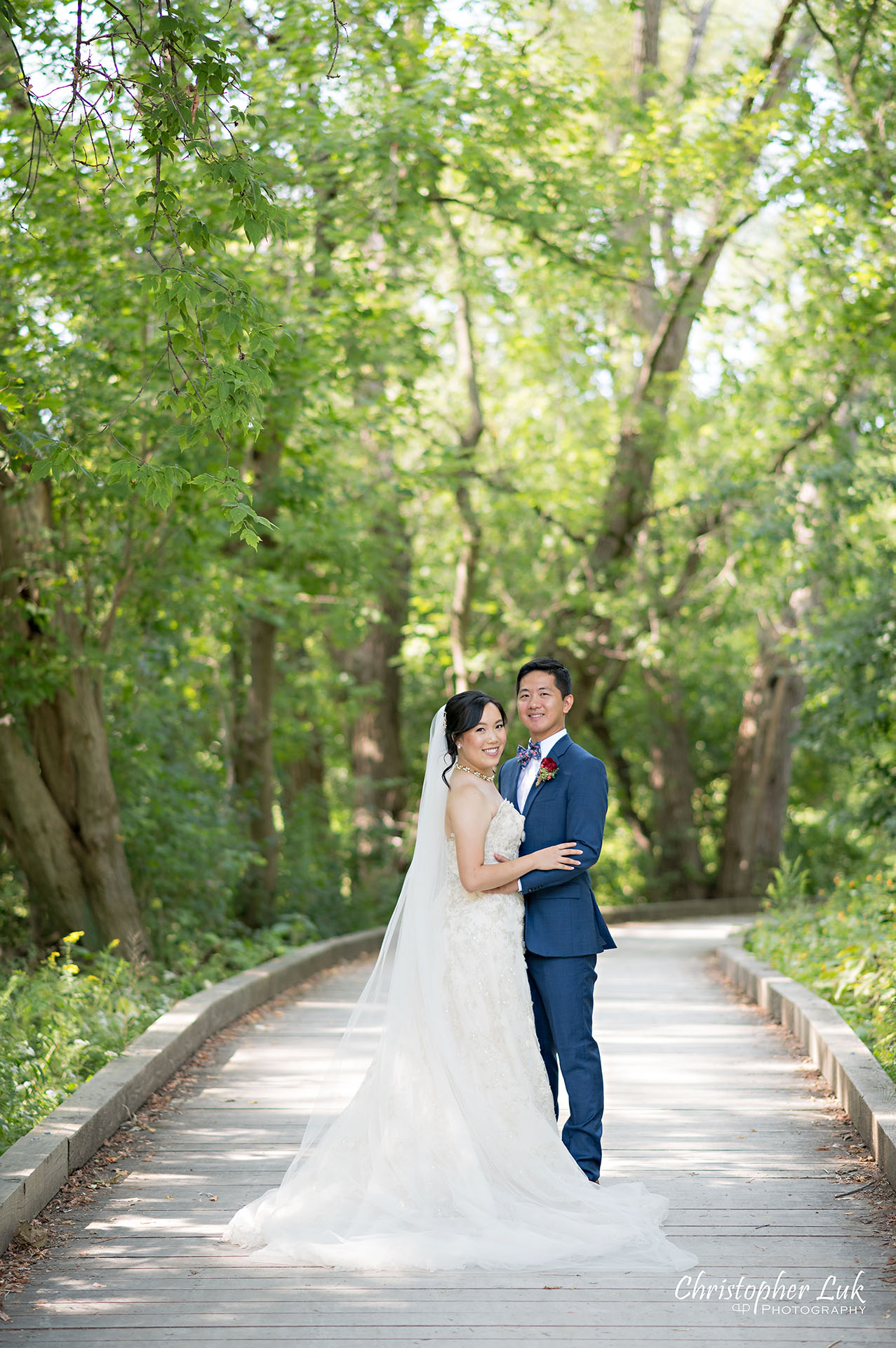 Christopher Luk Toronto Wedding Photographer Bridle Trail Baptist Church Unionville Main Street Crystal Fountain Event Venue Bride Groom Natural Photojournalistic Candid Creative Portrait Session Pictures Forest Trail Walkway Boardwalk Hug Kiss Portrait