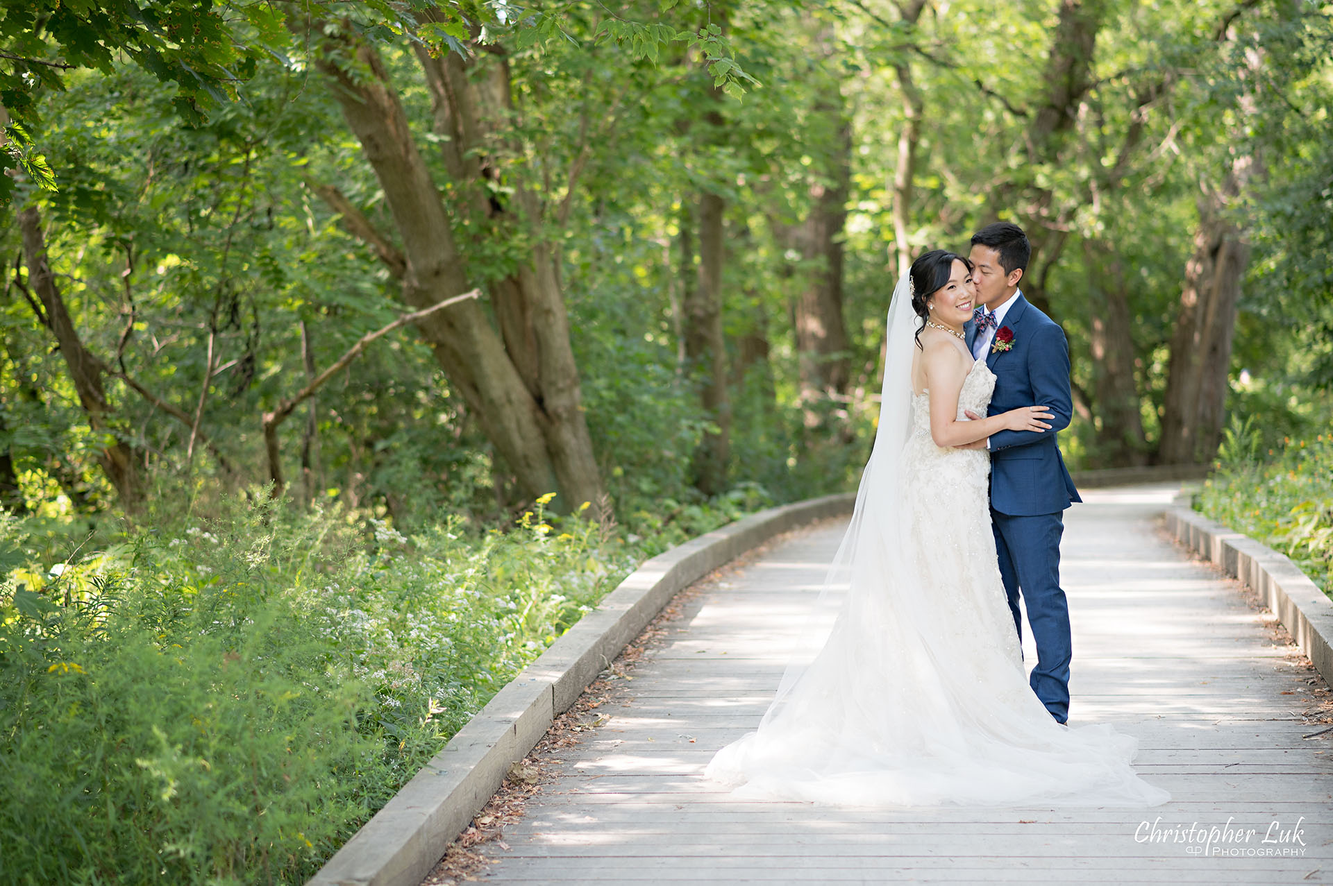 Christopher Luk Toronto Wedding Photographer Bridle Trail Baptist Church Unionville Main Street Crystal Fountain Event Venue Bride Groom Natural Photojournalistic Candid Creative Portrait Session Pictures Forest Trail Walkway Boardwalk Hug Kiss Landscape