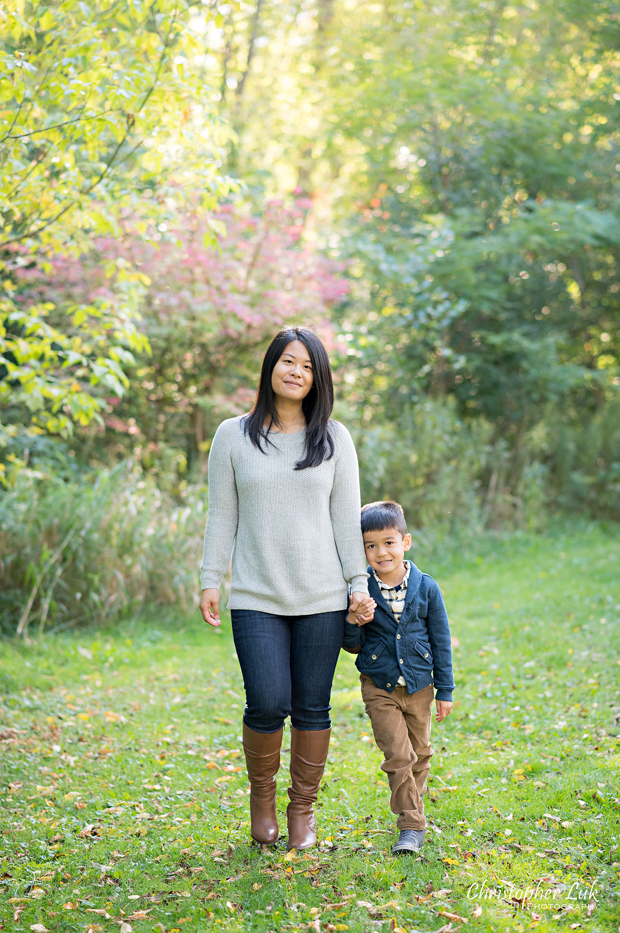 Christopher Luk Family Photographer Toronto Markham Unionville Autumn Fall Leaves Natural Candid Photojournalistic Mother Motherhood Son Brother Holding Hands Smile