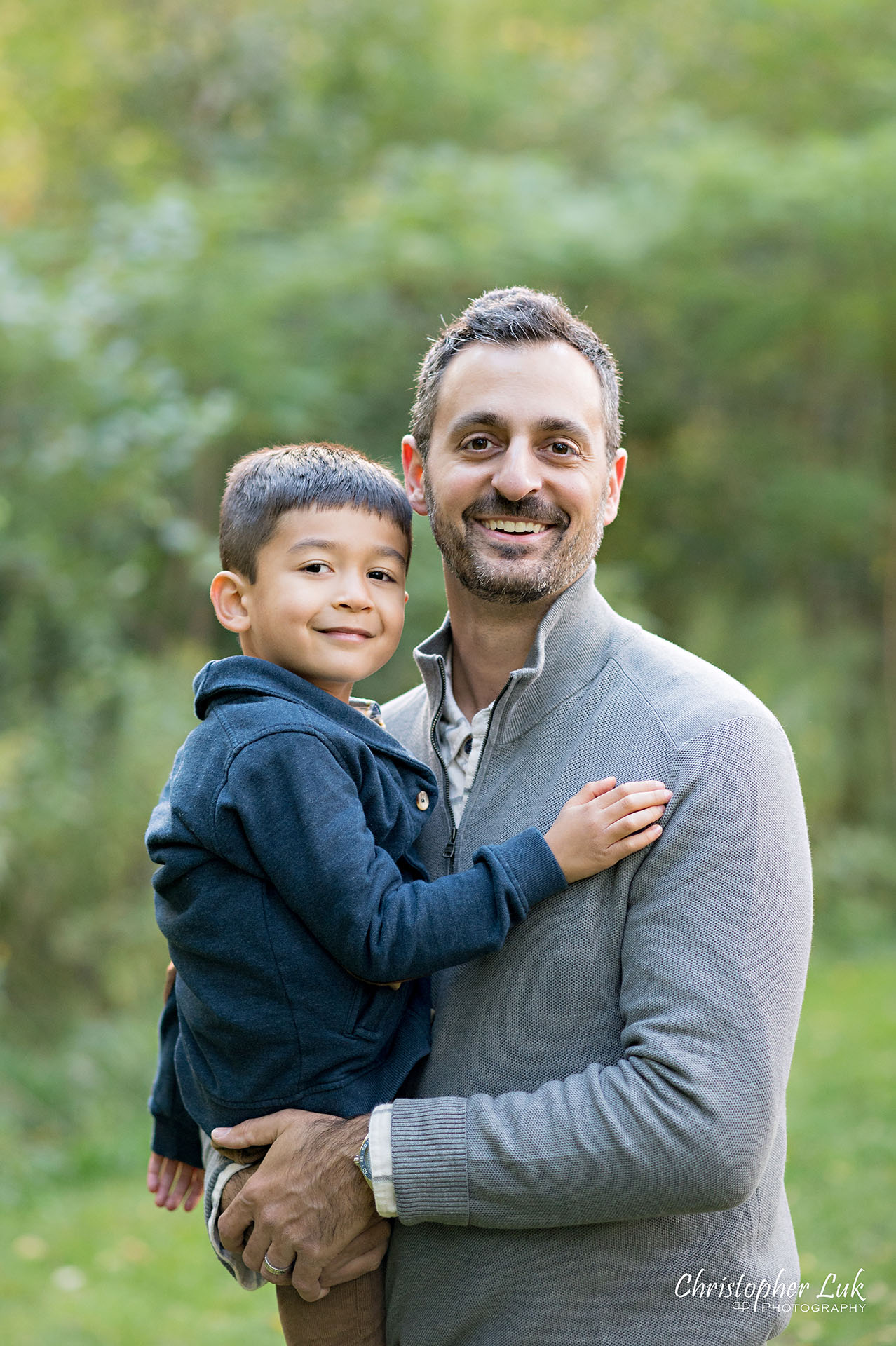 Christopher Luk Family Photographer Toronto Markham Unionville Autumn Fall Leaves Natural Candid Photojournalistic Father Fatherhood Son Brother Boy Smile Hug