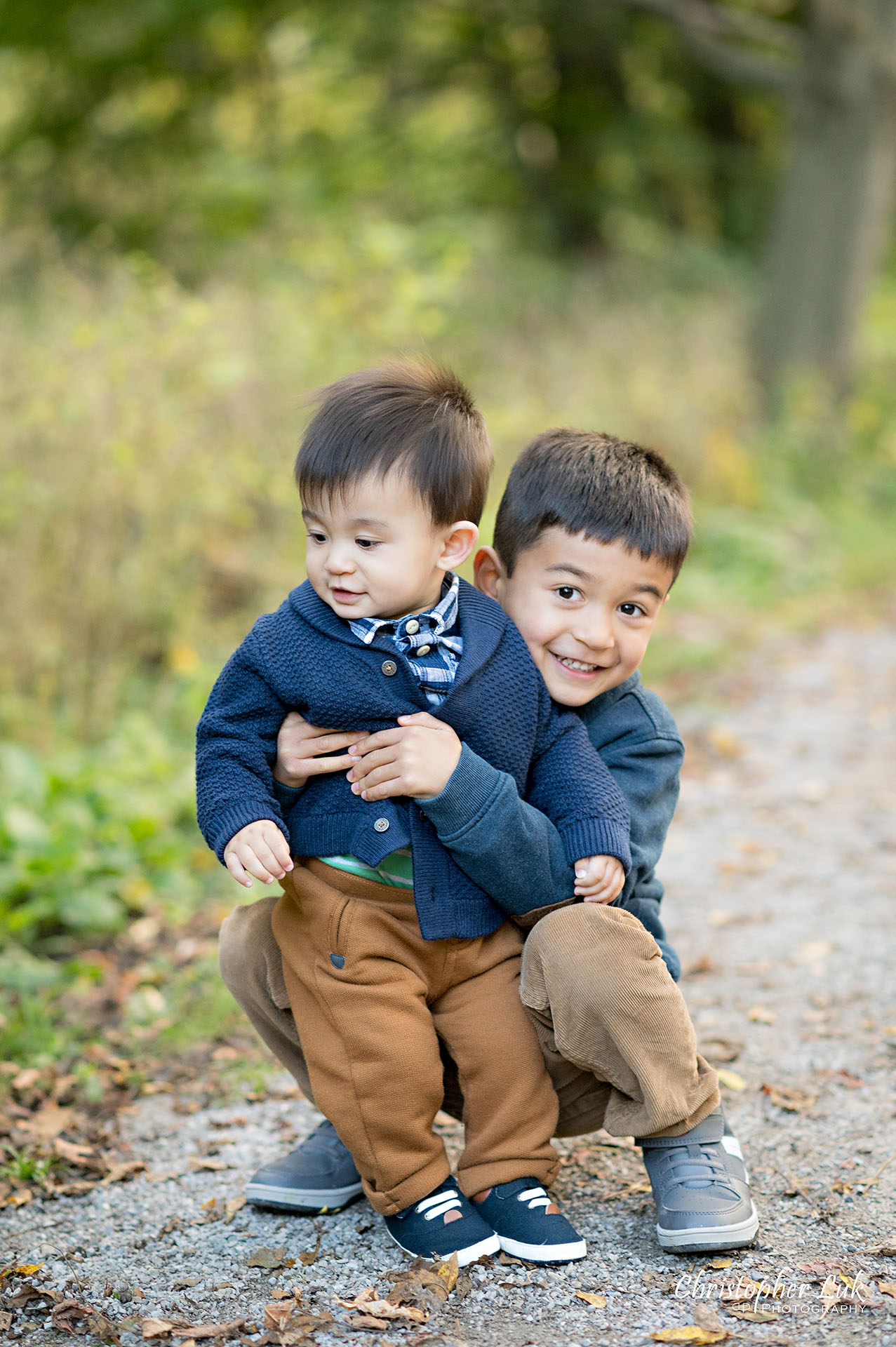 Christopher Luk Family Photographer Toronto Markham Unionville Autumn Fall Leaves Natural Candid Photojournalistic Sons Brothers Boys Smile Hug Funny