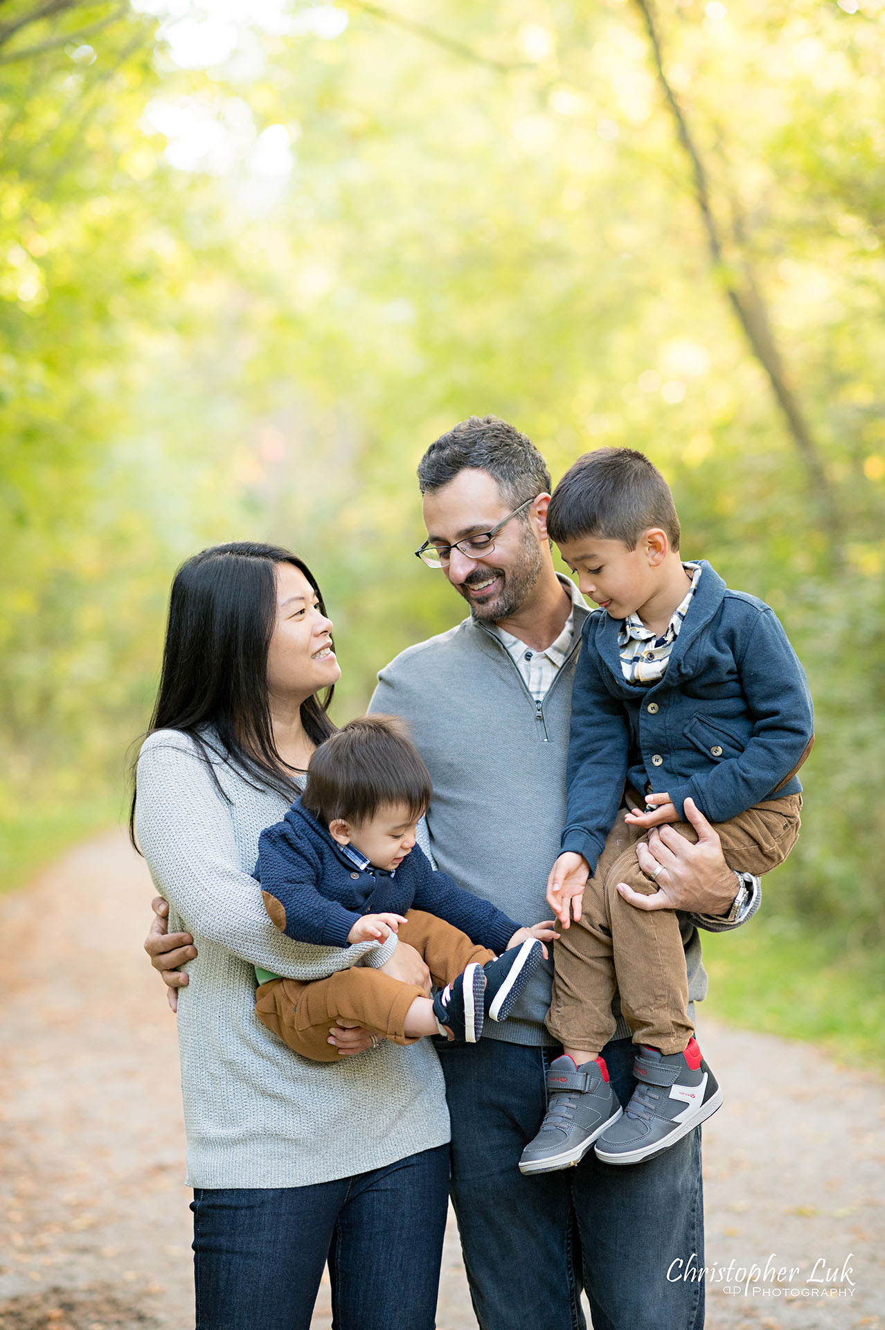 Christopher Luk Family Photographer Toronto Markham Unionville Autumn Fall Leaves Natural Candid Photojournalistic Sons Brothers Baby Boys Father Dad Mother Mom Motherhood Fatherhood Holding Hands Walking Together Trail Pathway Forest Fun Happy