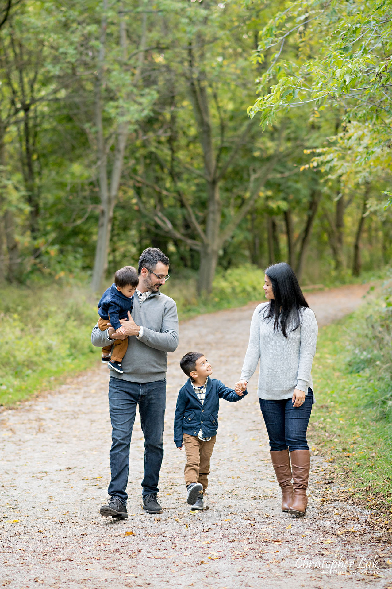 Christopher Luk Family Photographer Toronto Markham Unionville Autumn Fall Leaves Natural Candid Photojournalistic Sons Brothers Baby Boys Father Dad Mother Mom Motherhood Fatherhood Holding Hands Walking Together Trail Pathway Forest