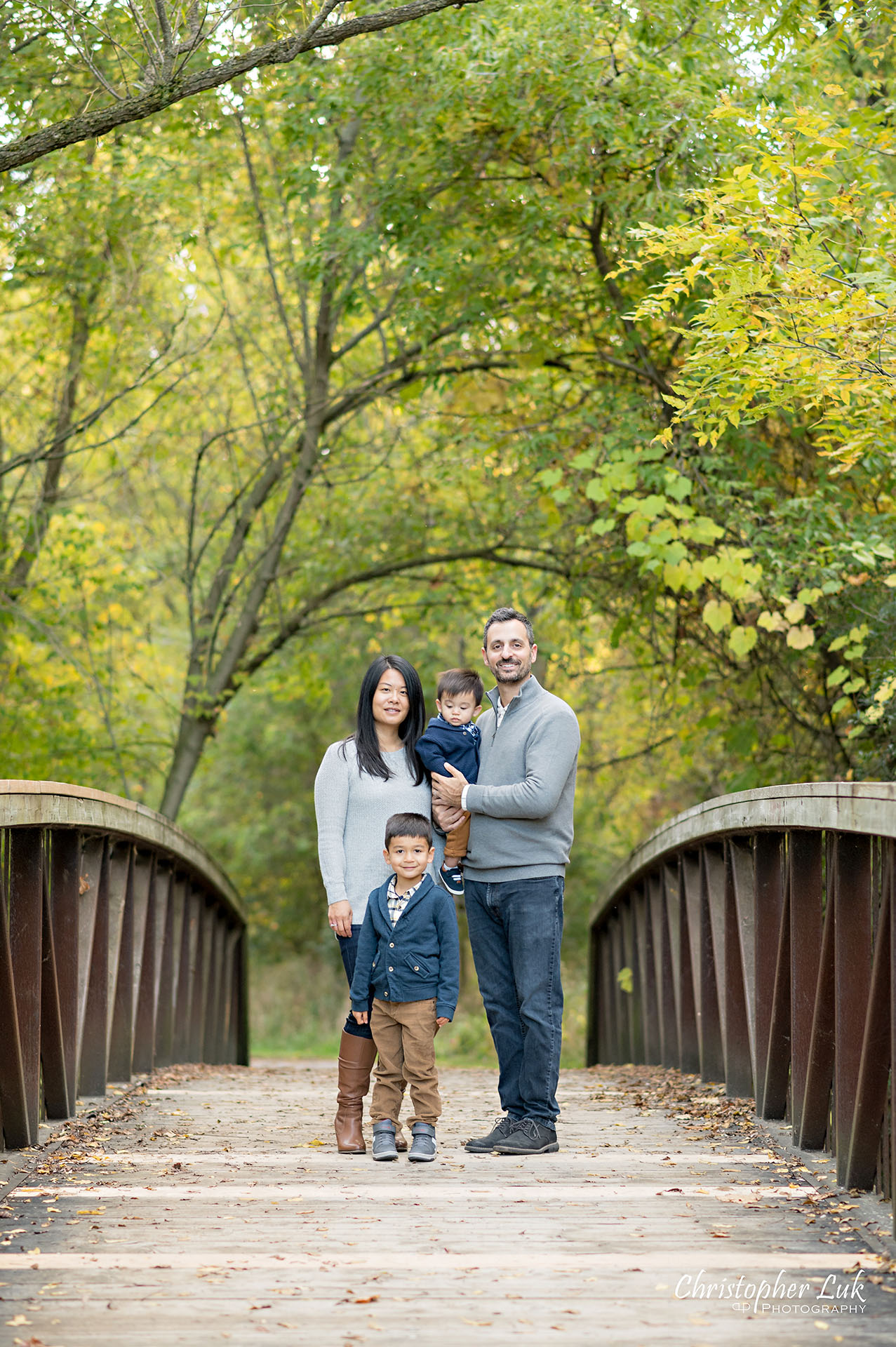 Christopher Luk Family Photographer Toronto Markham Unionville Autumn Fall Leaves Natural Candid Photojournalistic Sons Brothers Baby Boys Bridge Father Dad Mother Mom Motherhood Fatherhood Smile