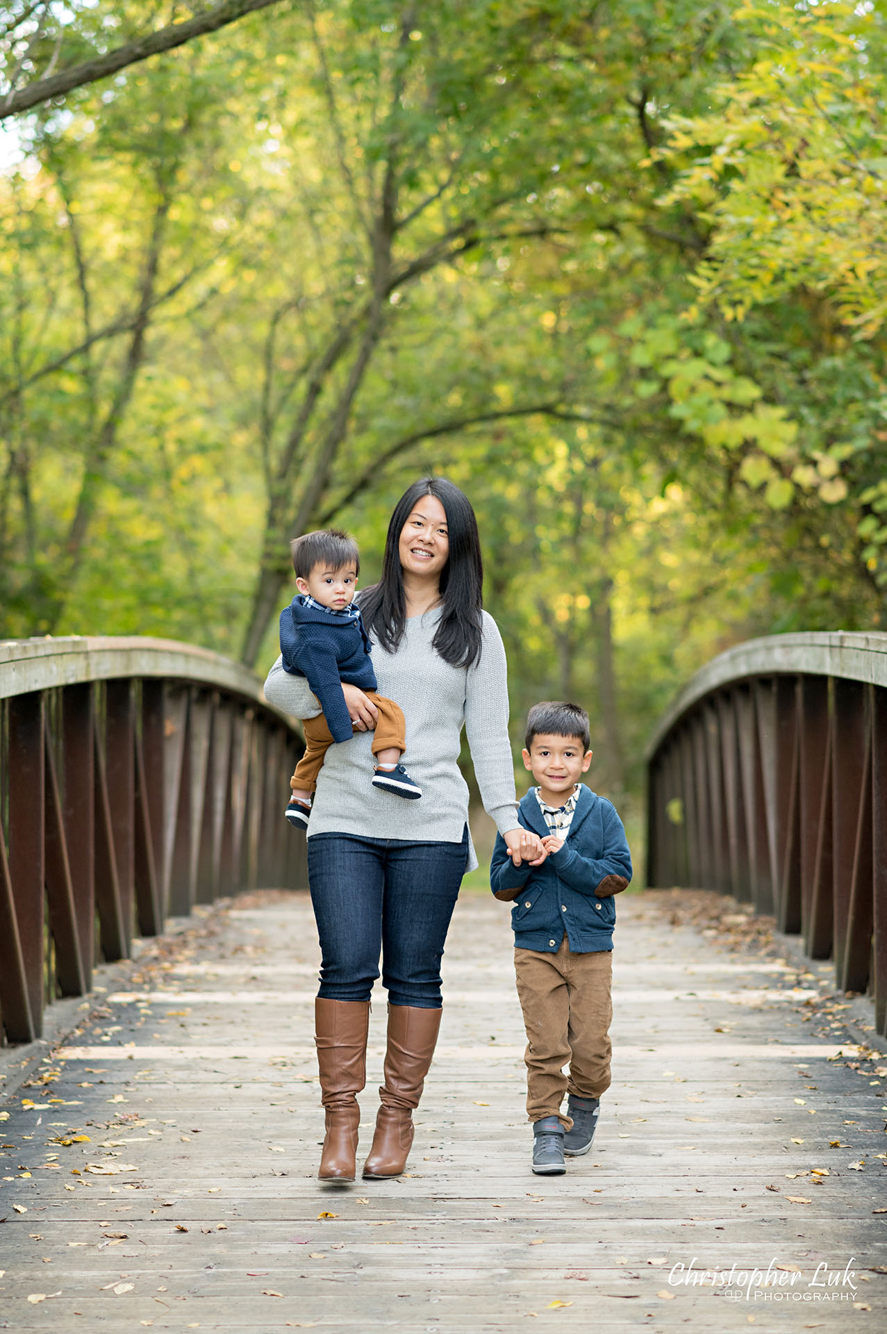 Christopher Luk Family Photographer Toronto Markham Unionville Autumn Fall Leaves Natural Candid Photojournalistic Sons Brothers Baby Boys Bridge Mother Mom Motherhood Holding Hands Walking