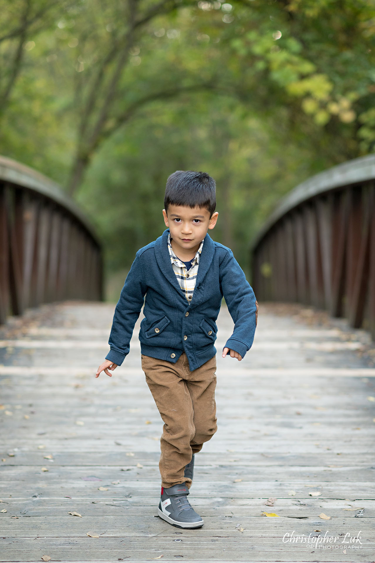 Christopher Luk Family Photographer Toronto Markham Unionville Autumn Fall Leaves Natural Candid Photojournalistic Son Brother Boy Standing Funny Pose Bridge