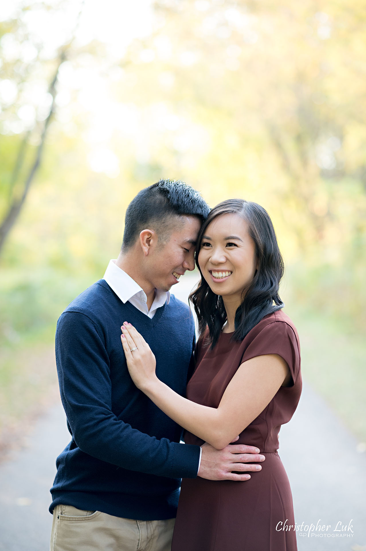 Christopher Luk Toronto Wedding Engagement Session Photographer Autumn Fall Leaves Natural Candid Photojournalistic Bride Groom Hugging Hug Holding Each Other Together Pathway Hiking Trail Detail