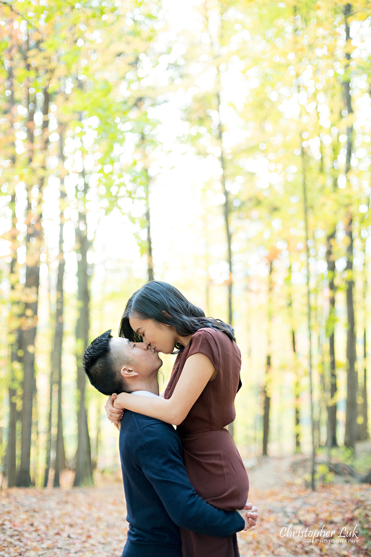 Christopher Luk Toronto Wedding Engagement Session Photographer Autumn Fall Leaves Natural Candid Photojournalistic Bride Groom Hiking Trail Trees Lift Hug Carry Kiss Each Other