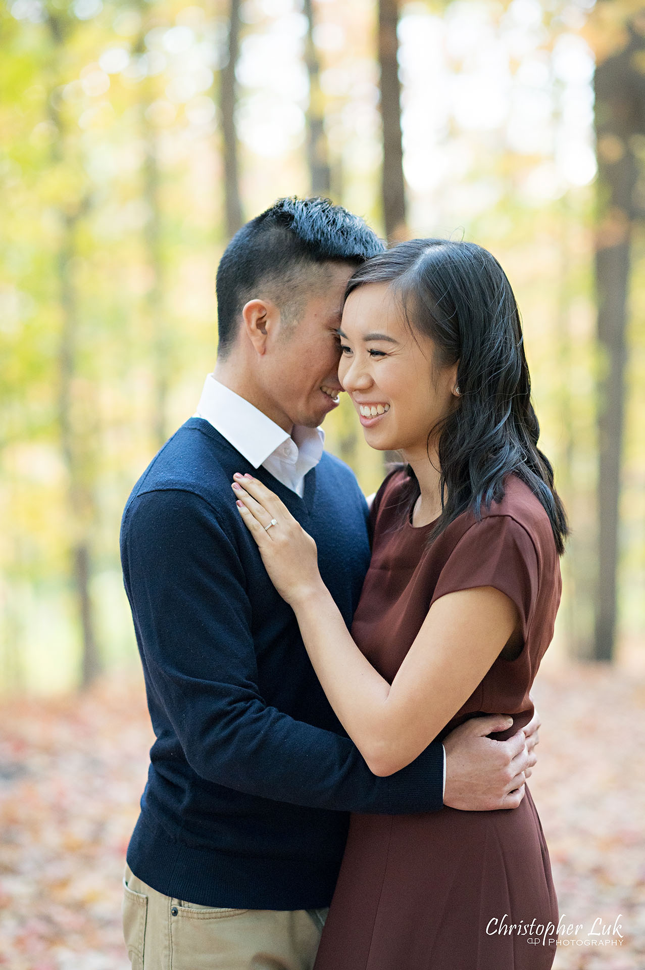 Christopher Luk Toronto Wedding Engagement Session Photographer Autumn Fall Leaves Natural Candid Photojournalistic Bride Groom Hiking Trail Trees Smiling Hug Hugging Each Other Happy Together