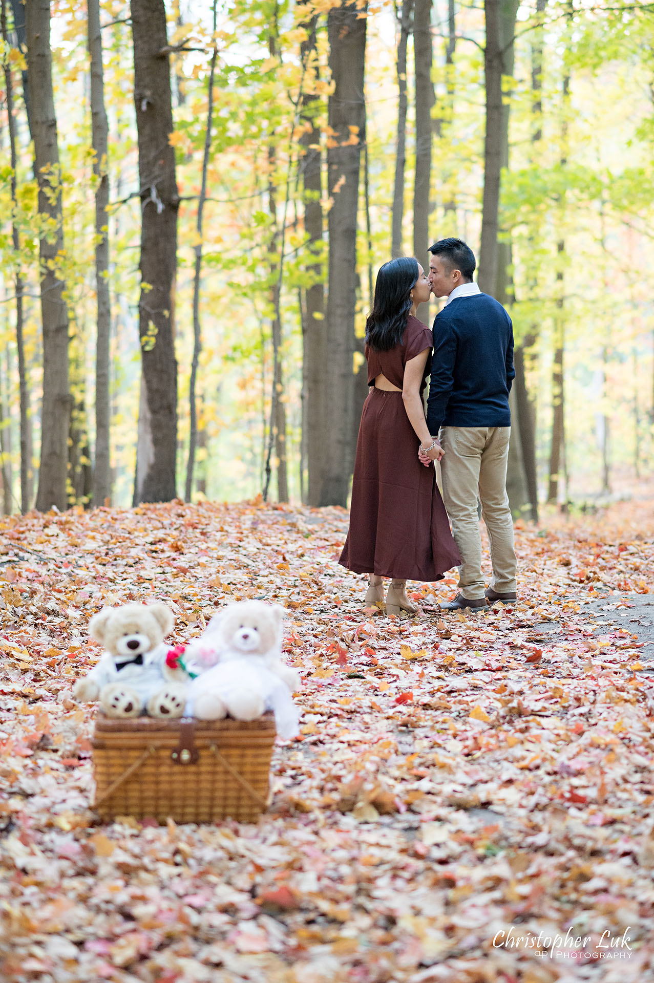 Christopher Luk Toronto Wedding Engagement Session Photographer Autumn Fall Leaves Natural Candid Photojournalistic Bride Groom Hiking Trail Stuffed Animal WongFu Productions Spencer Bear Picnic Basket Trees Kiss